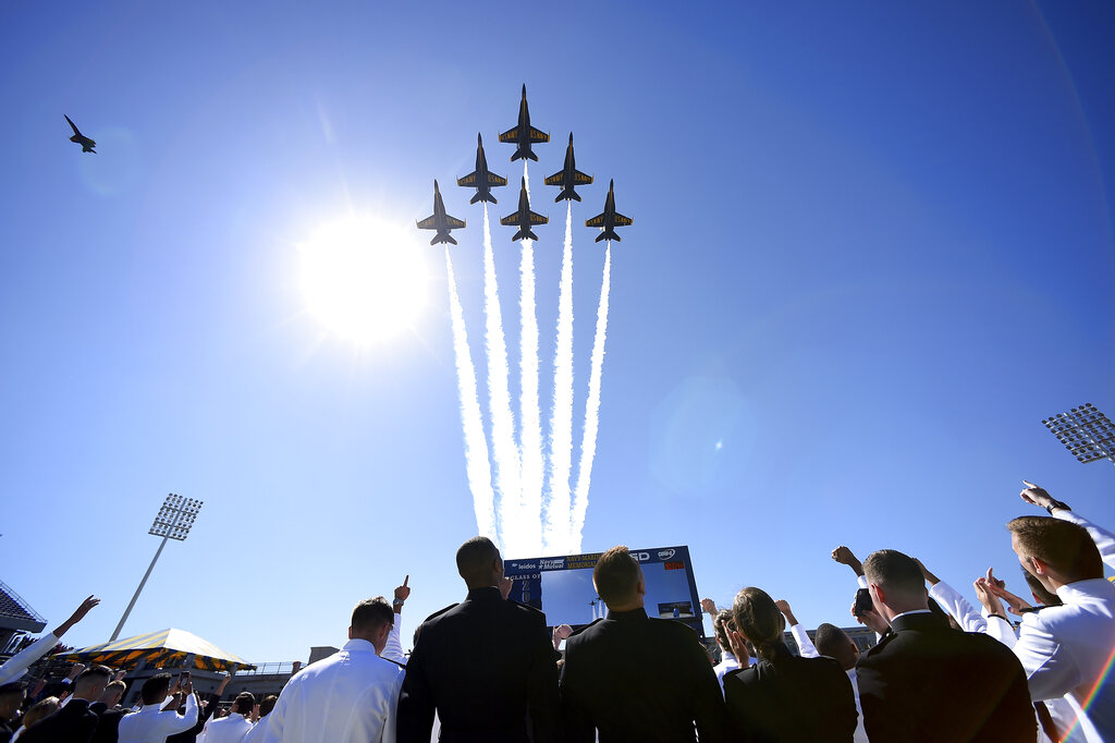 The Blue Angels flight demonstration team flies over graduating members of the U.S. Naval Academy on Friday in Annapolis, Md. (Will Newton/AP)