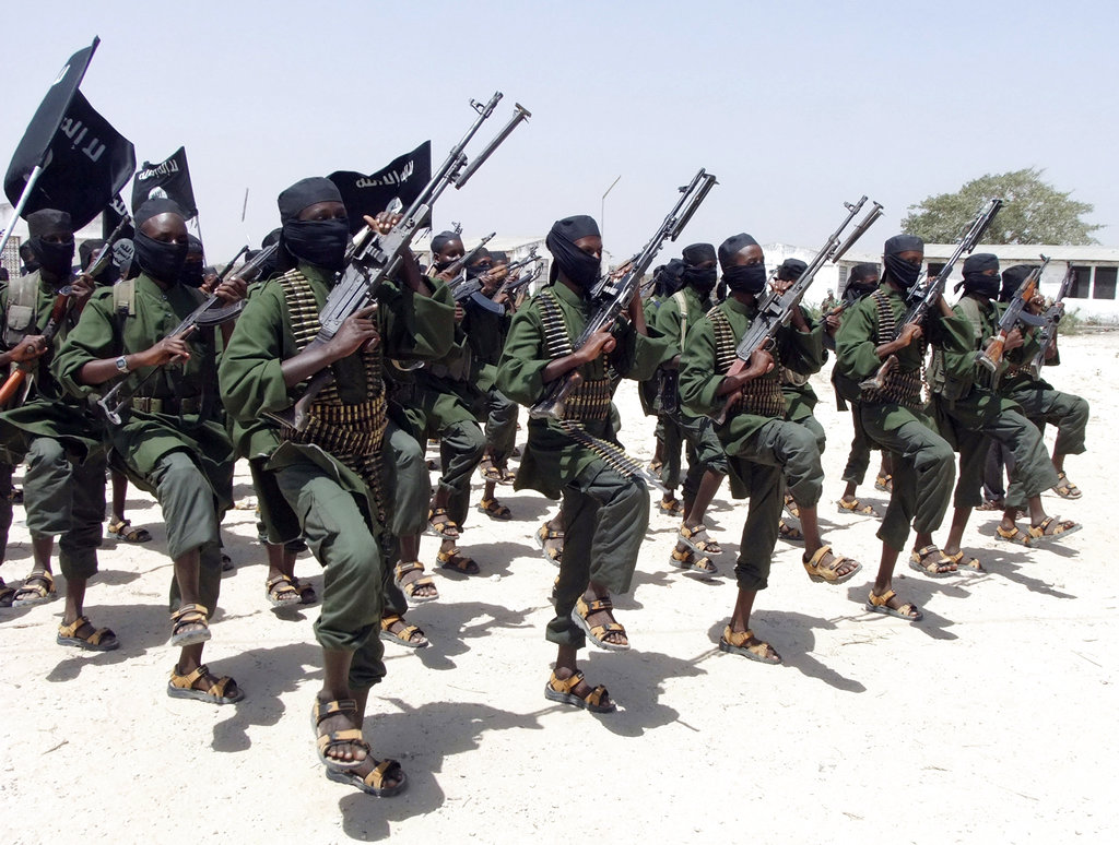 In this Feb. 17, 2011, file photo, hundreds of newly trained al-Shabab fighters perform military exercises in the Lafofe area south of Mogadishu, Somalia. (Farah Abdi Warsameh/AP)