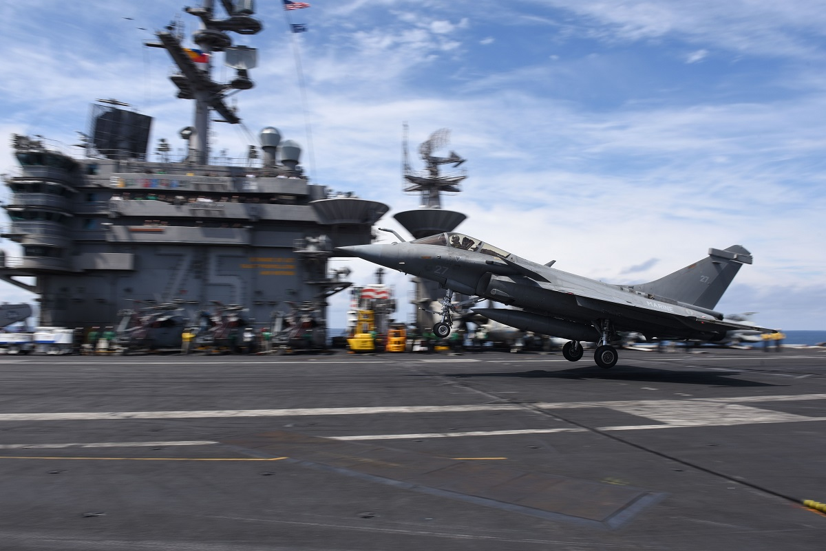 A French Dassault Rafale M fighter touches down on the flight deck aboard the Nimitz-class aircraft carrier Harry S. Truman. (U.S. Navy)