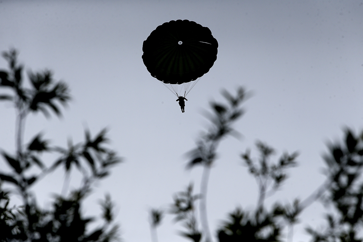 Parachutists jump from C-47 transport planes in Carentan, Normandy, France, Wednesday, June 5, 2019. Approximately 200 parachutists participated in the jump over Normandy on Wednesday, replicating a jump made by U.S. soldiers on June 6, 1944, as a prelude to the seaborne invasions on D-Day. (Rafael Yaghobzadeh/AP)