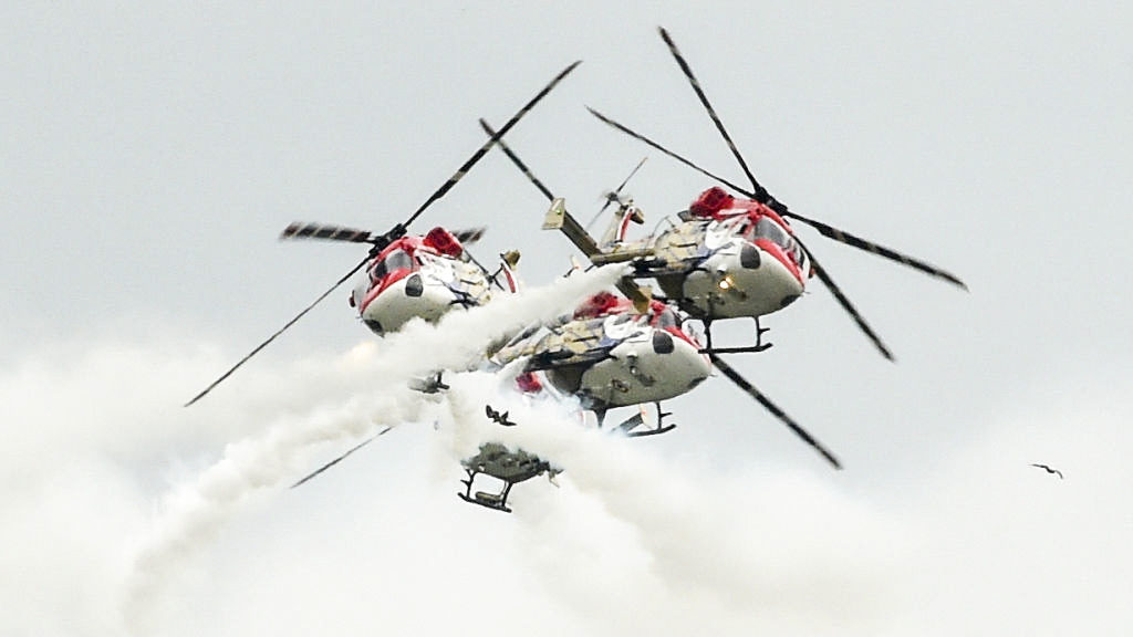 Indian Air Force (IAF) SARANG helicopters display team perform at Vadodara Air Force Station, some 110 kms from Ahmedabad on September 27, 2019. - 'Know Your Air Force' event is organized in a run up to the momentous occasion of 87th Air Force Day Celebrations which falls on October 8, 2019. (SAM PANTHAKY/AFP/Getty Images)