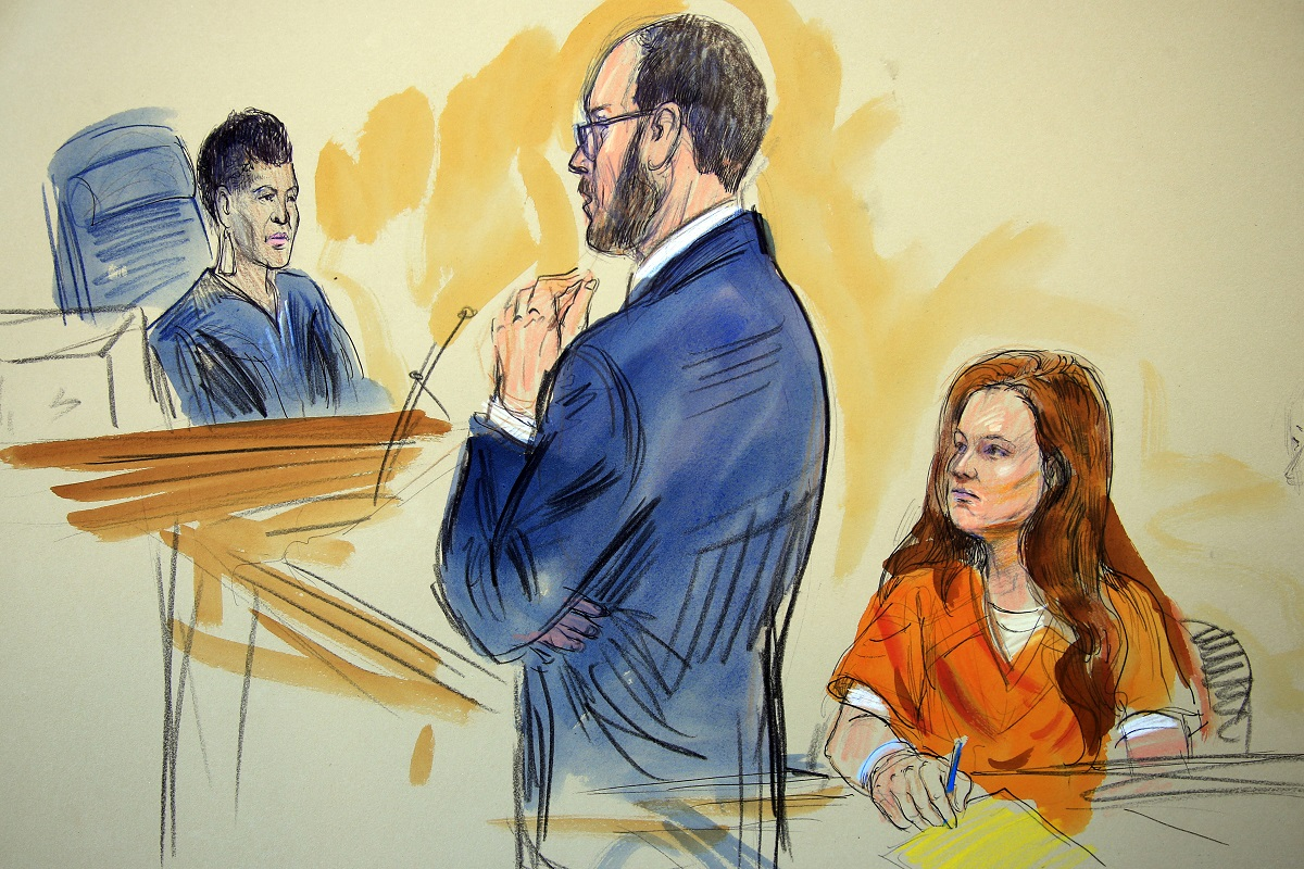 This July 18, 2018, file courtroom sketch depicts Maria Butina, listening to Assistant U.S. Attorney Erik Kenerson as he speaks to Judge Deborah Robinson, left, during a hearing in federal court in Washington. New court papers reveal that Butina, accused of being a Russian agent, is in negotiations with federal prosecutors about a