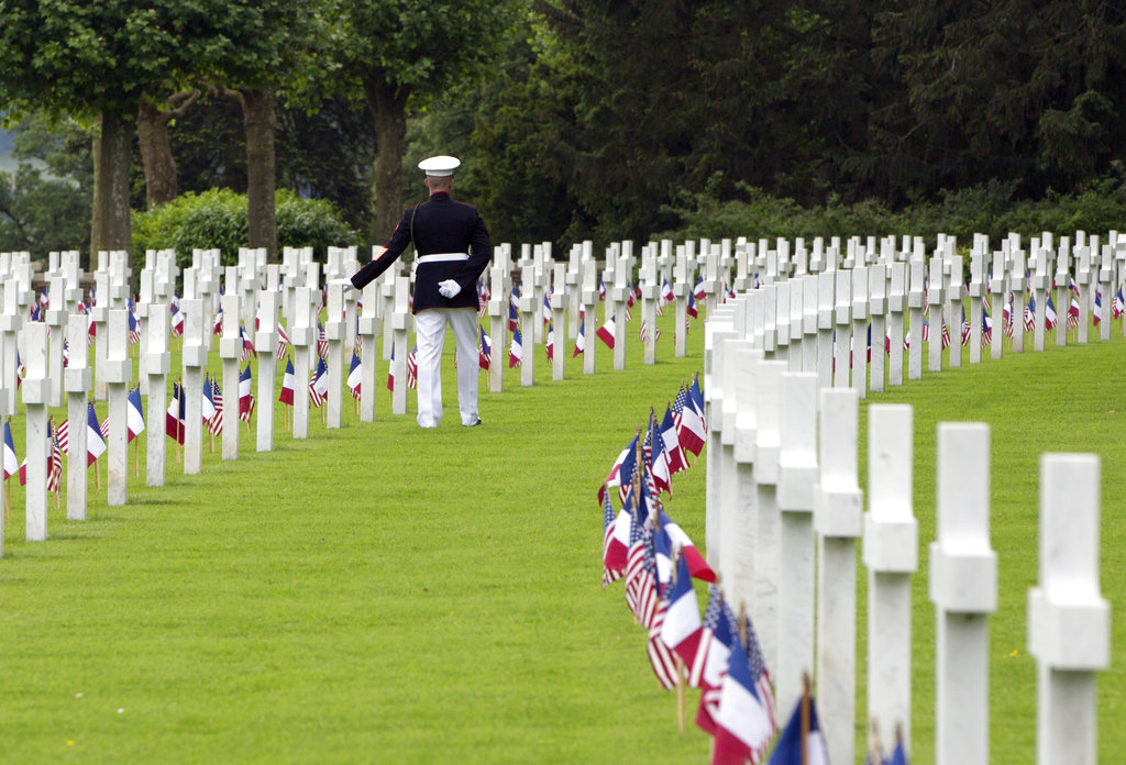U.S. Marine Corps Sgt. Maj. Darrell Carver touches a headstone as he walks prior to a Memorial Day commemoration at the Aisne-Marne American Cemetery in Belleau, France, Sunday, May 27, 2018. The cemetery contains more that 2,000 American dead. (Virginia Mayo/AP)