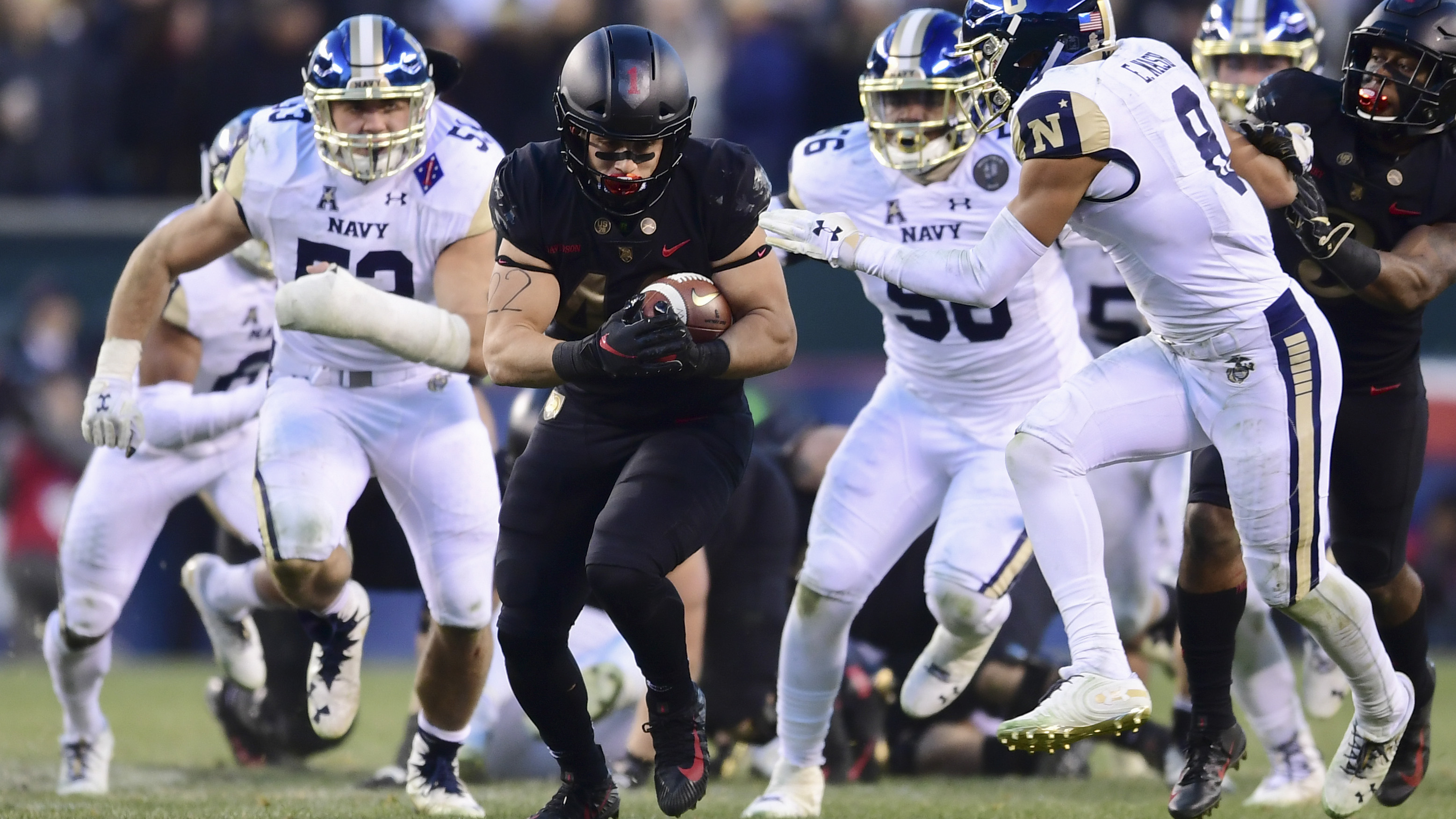 PHILADELPHIA, PENNSYLVANIA - DECEMBER 08: Calen Holt #22 of the Army Black Knights carries the ball during the second quarter of the game against the Navy Midshipmen at Lincoln Financial Field on December 08, 2018 in Philadelphia, Pennsylvania. (Photo by Sarah Stier/Getty Images)