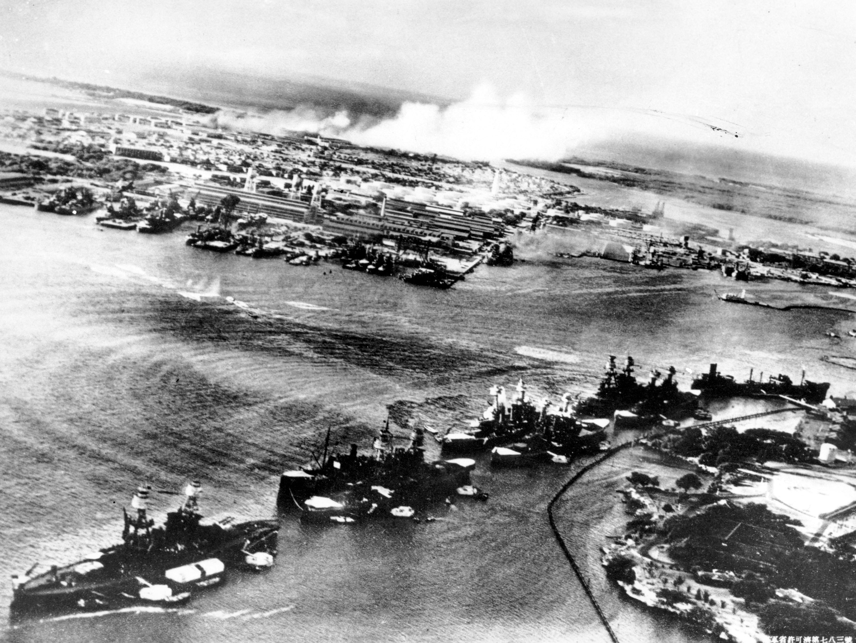 This picture, taken by a Japanese photographer, shows how American ships are clustered together before the surprise Japanese aerial attack on Pear Harbor, HI., on Sunday morning, Dec. 8, 1941. Minutes later the full impact of the assault was felt and Pearl Harbor became a flaming target. (AP Photo)