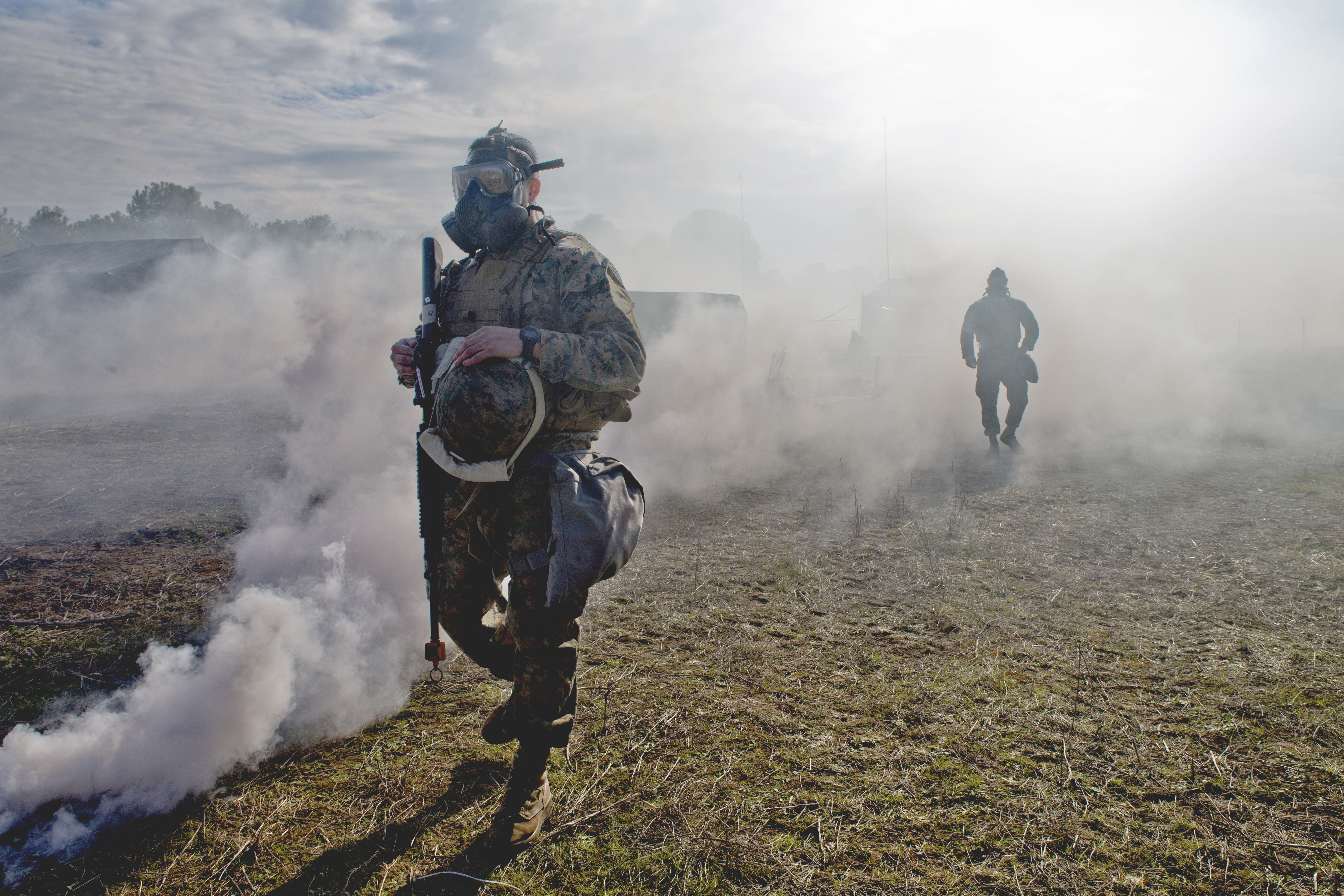 U.S. Marines with Special-Purpose Marine Air-Ground Task Force-Crisis Response-Africa, logistics combat element, simulate a gas attack during a field exercise at Morón Air Base, Spain, Feb. 7, 2018. SPMAGTF-CR-AF is deployed to conduct limited crisis-response and theater-security operations in Europe and North Africa. (U.S. Marine Corps photo by Sgt. Takoune H. Norasingh/Released)