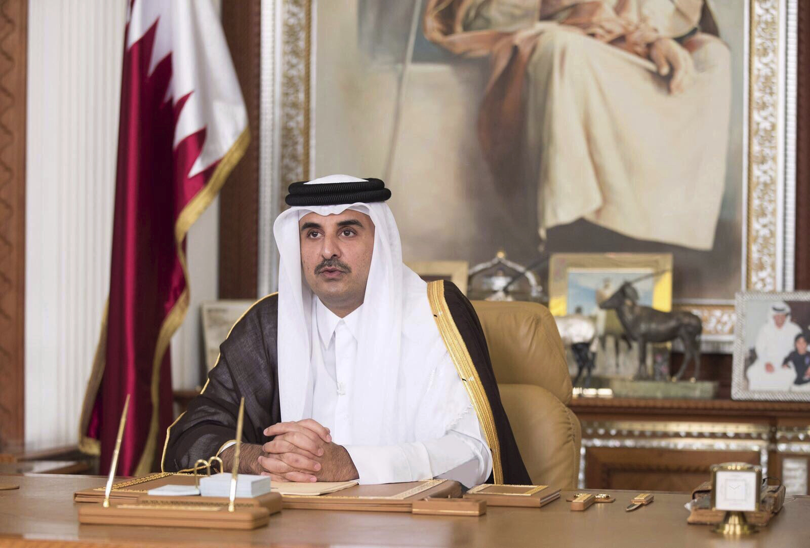 Qatar's emir warns against military action in Gulf dispute
