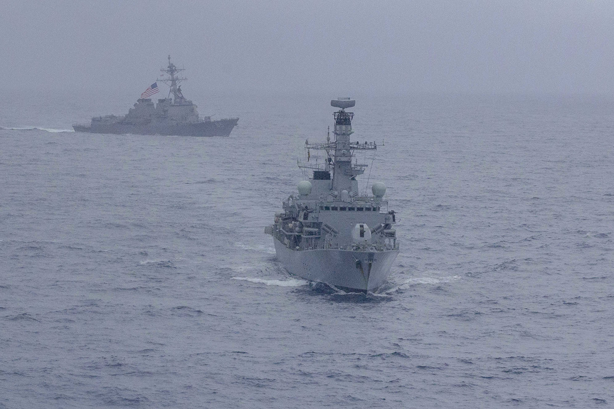 The Arleigh Burke-class guided-missile destroyer USS McCampbell (DDG 85) and the Royal Navy Type 23 'Duke' Class guided-missile frigate HMS Argyll (F231) maneuver Jan. 15, 2019, during a divisional tactics exercise in the South China Sea. (MC2 John Harris/Navy)