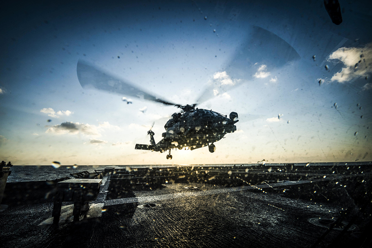An MH-60R Sea Hawk helicopter takes off from the flight deck of the Ticonderoga-class guided-missile cruiser USS Chancellorsville (CG 62) on Nov. 14, 2018, during flight quarters in the Philippine Sea. (MC2 Sarah Myers/Navy)