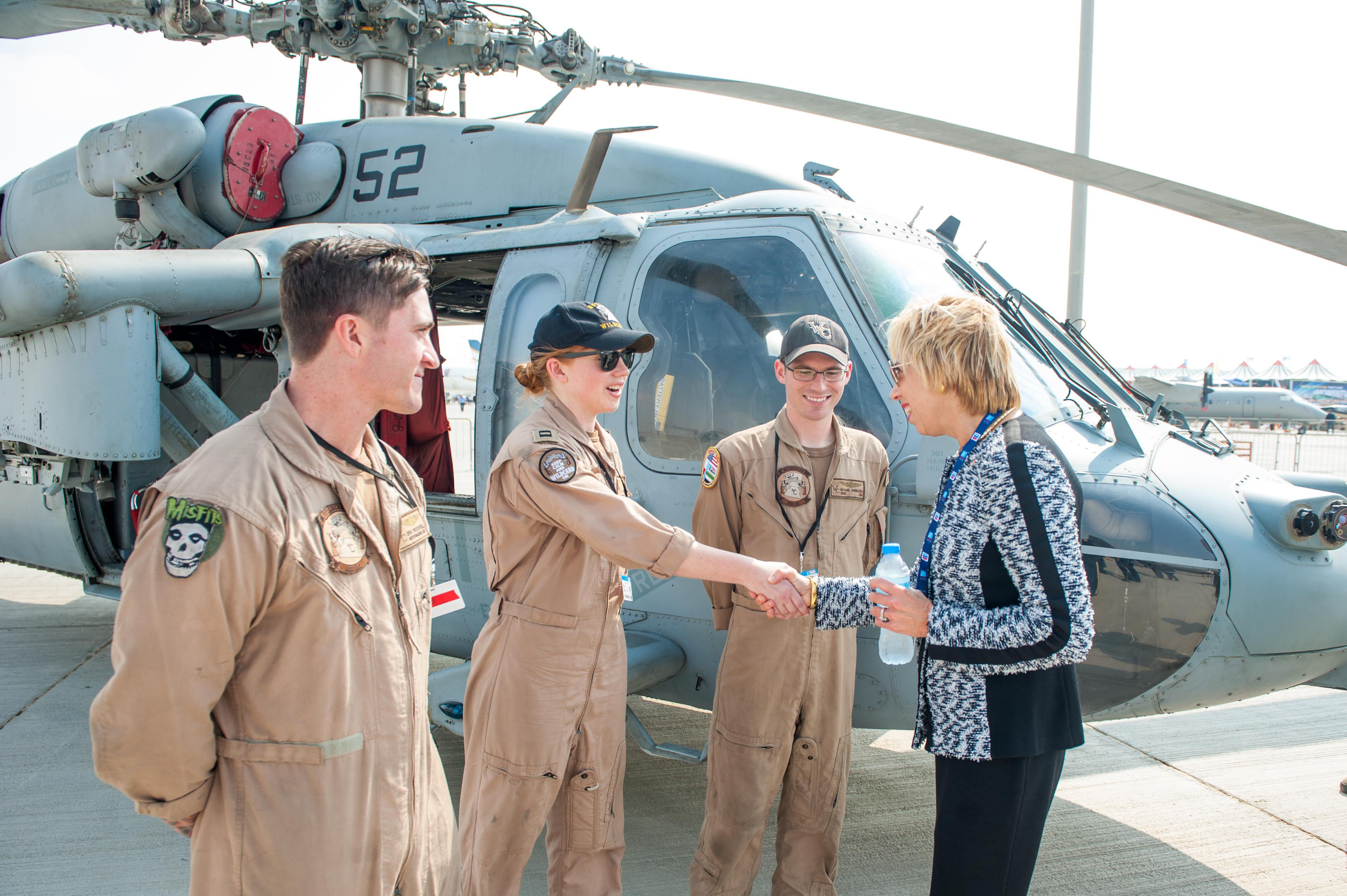 Ellen Lord, pentagon acquisition head, meets with a crew of an MH-60S Seahawk helicopter at the Dubai Airshow in November 2017. Lord is working to change the current acquisition setup. (Alexander A. Ventura II/U.S. Navy)