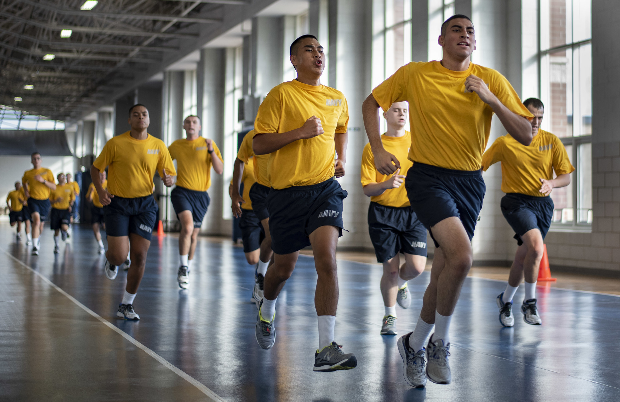 Recruits run sprints during a physical training session on Oct. 24, 2018, inside Freedom Hall at Recruit Training Command at Great Lakes, Ill. (MC2 Spencer Fling/Navy)