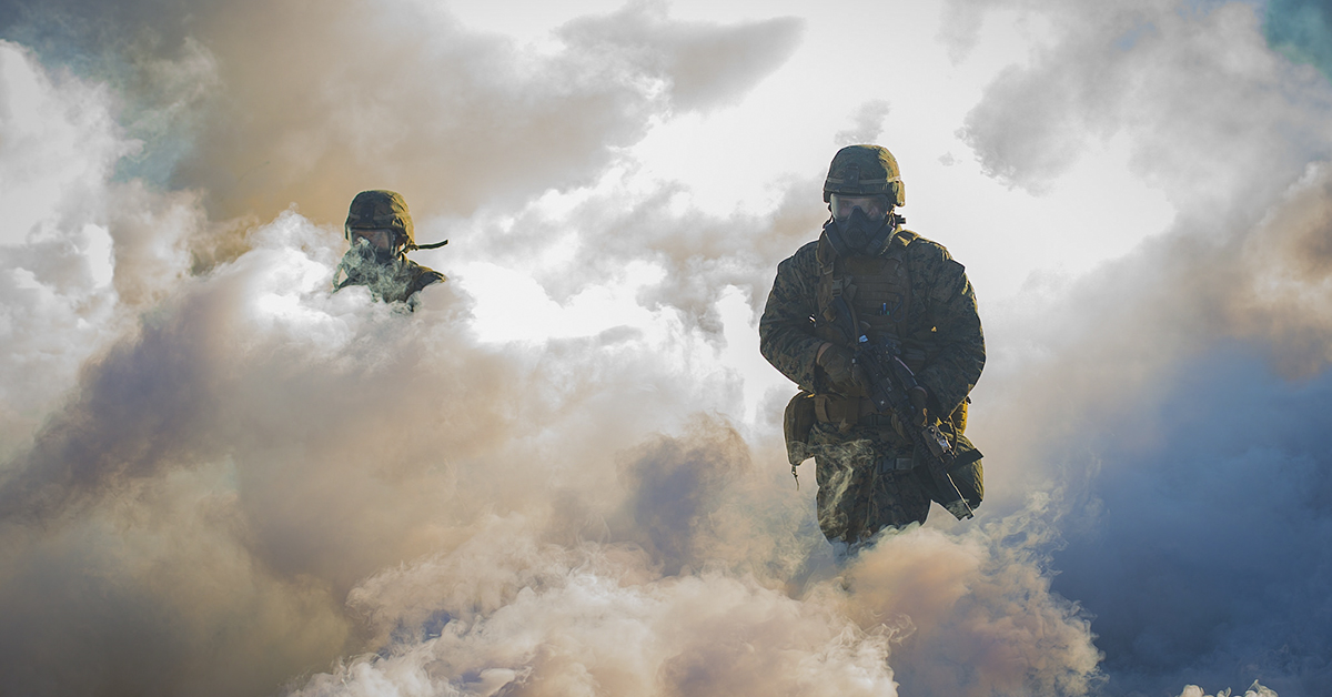 Marines run through CS gas during the hike portion of the 1st Marine Division Super Squad Competition at Marine Corps Base Camp Pendleton, California, Aug. 30, 2018. (Lance Cpl. Audrey M.C. Rampton/Marine Corps)