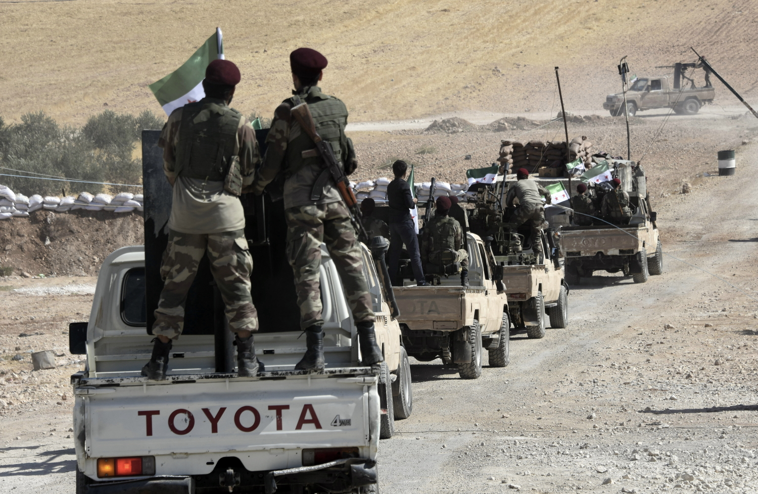 Turkey-backed FSA fighters are heading toward Syrian town of Tal Abyad from Turkish border town of Akcakale, Turkey, Thursday, Oct. 10, 2019. Turkish President Recep Tayyip Erdogan says that there have been 109