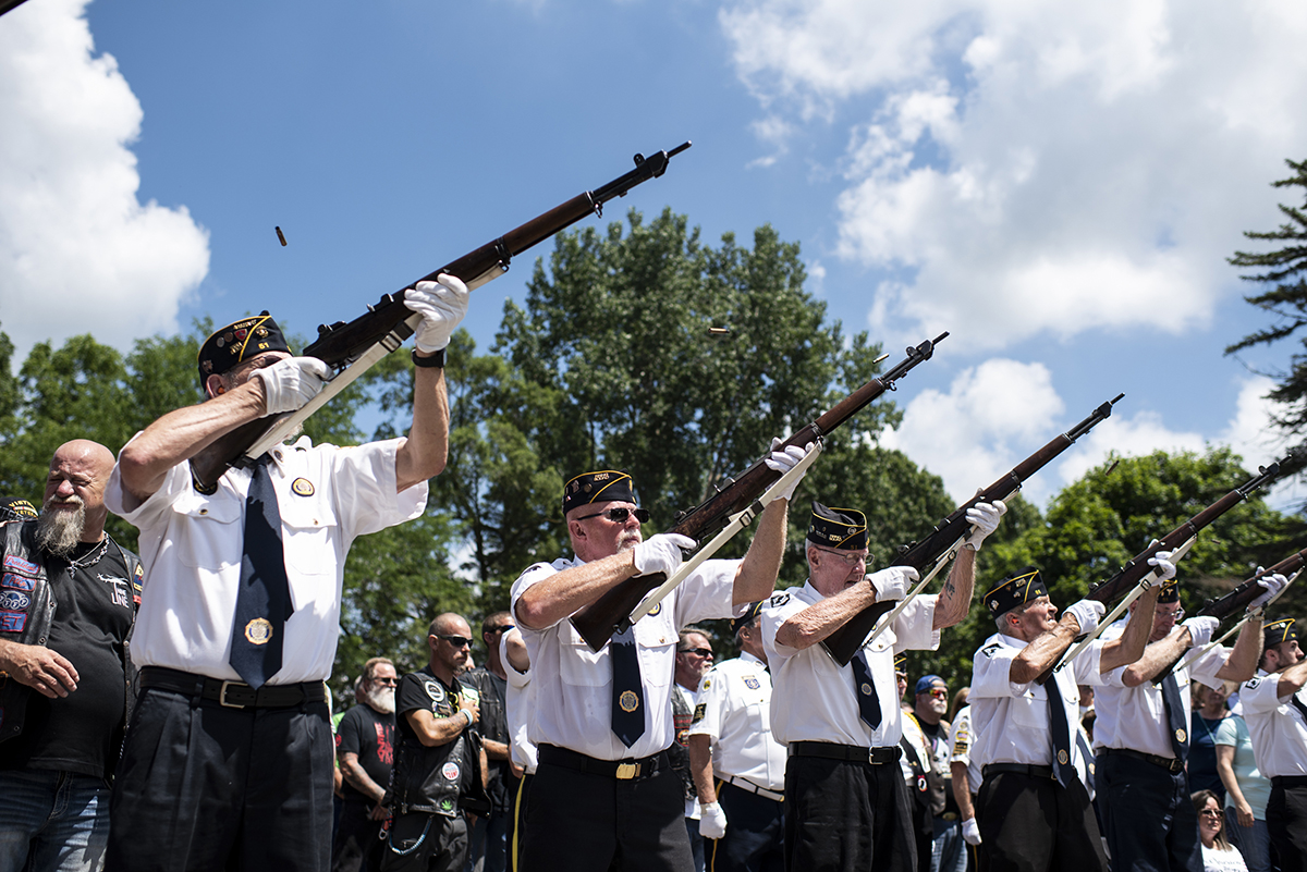 Veterans perform a gun salute during his memorial service of Vietnam War veteran Wayne Wilson at the Silverbrook Cemetery in Niles, Mich., Wednesday, July 17, 2019. (Emil Lippe/Kalamazoo Gazette via AP)