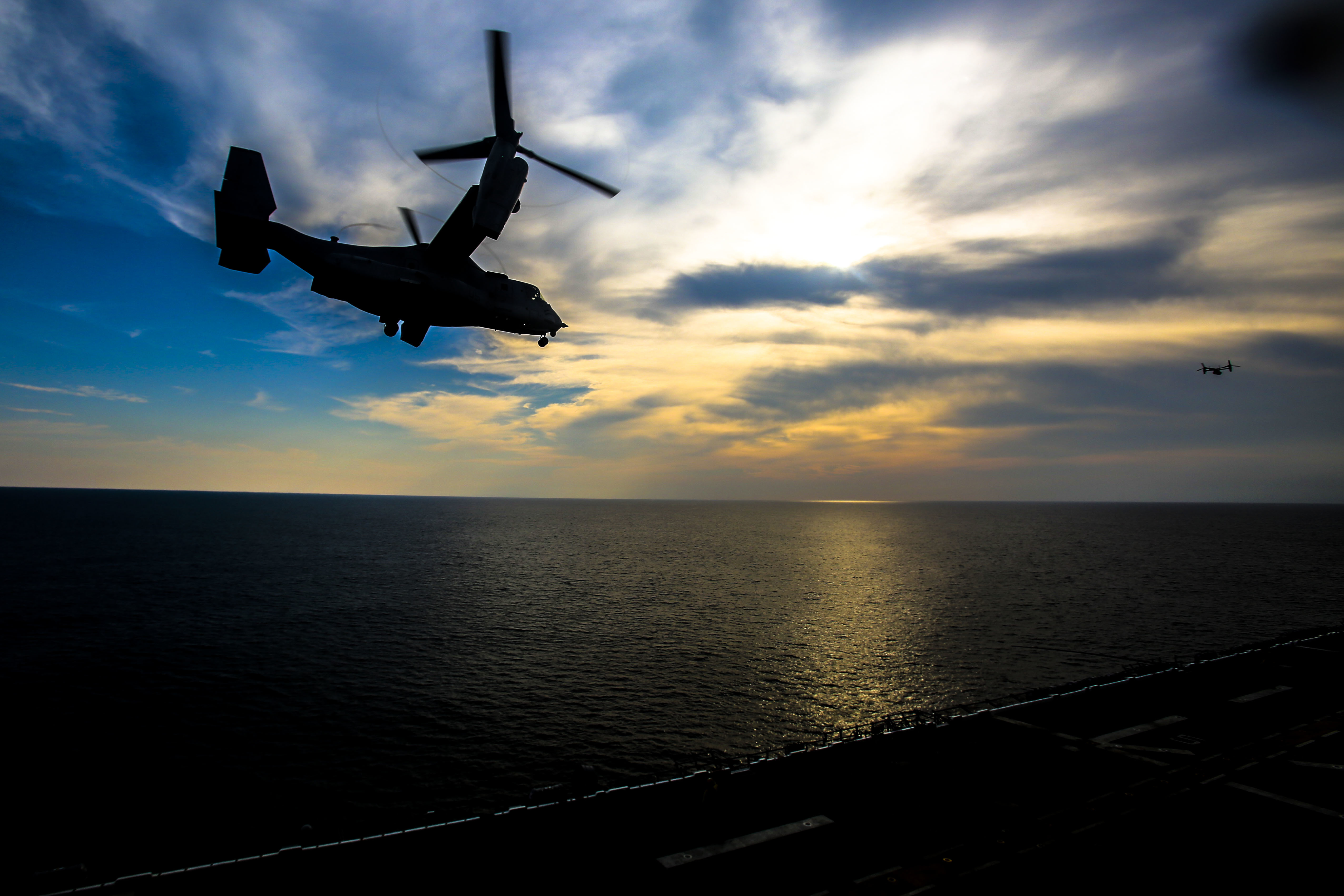 A U.S. Marine Corps MV-22B Osprey with Marine Medium Tiltrotor Squadron 162 (Reinforced), 26th Marine Expeditionary Unit (MEU), takes off from the amphibious assault ship USS Iwo Jima (LHD-7) as part of Combined Composite Training Unit Exercise (COMPTUEX) in the Atlantic Ocean. (Cpl. Jon Sosner/Marine Corps)