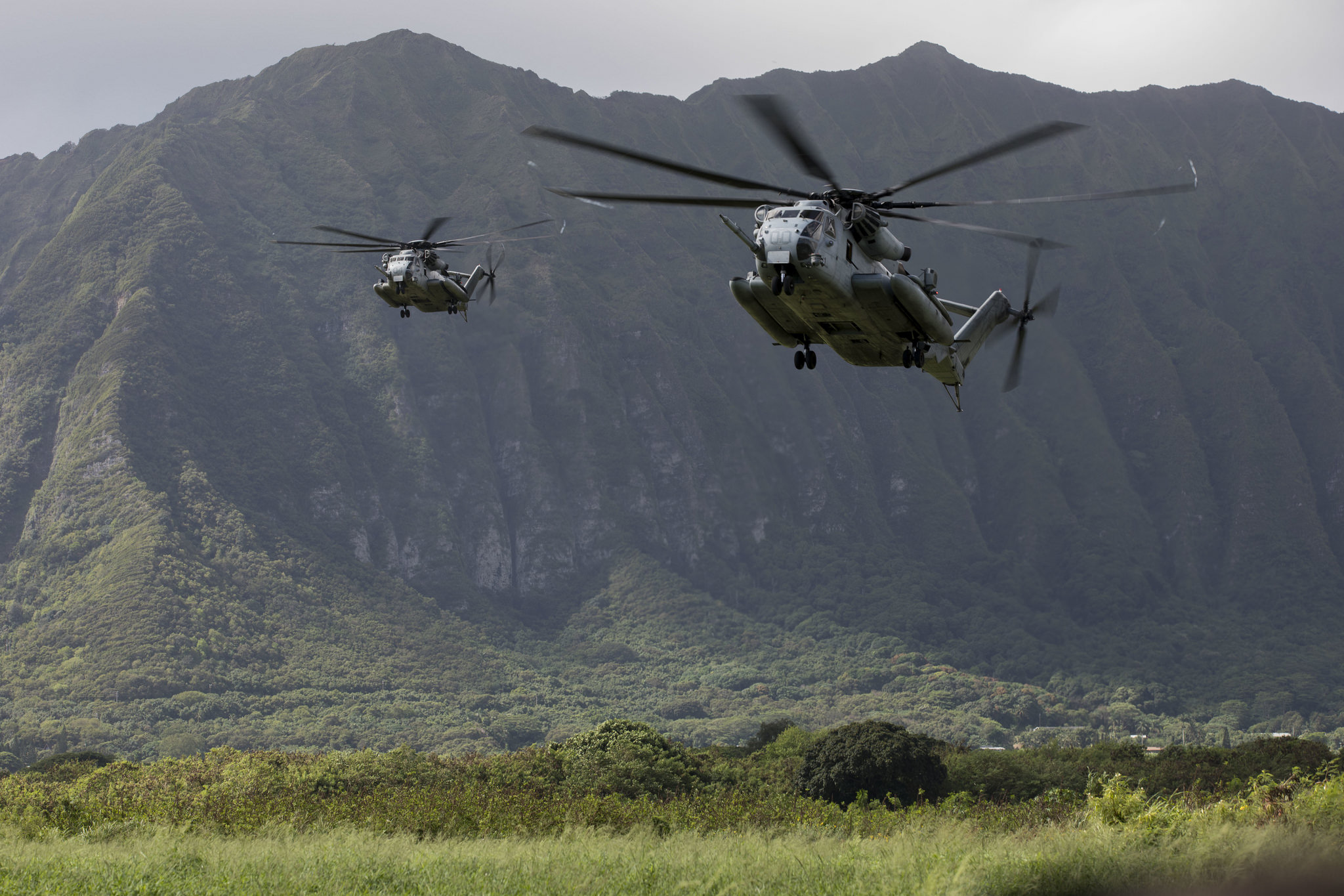 U.S. Marine Corps CH-53E Super Stallions prepare to land and drop off U.S. Marines on Sept. 18, 2018, during a helicopter insertion exercise at Marine Corps Training Area Bellows (MCTAB), Hawaii. (Sgt. Jesus Sepulveda Torres/Marine Corps)