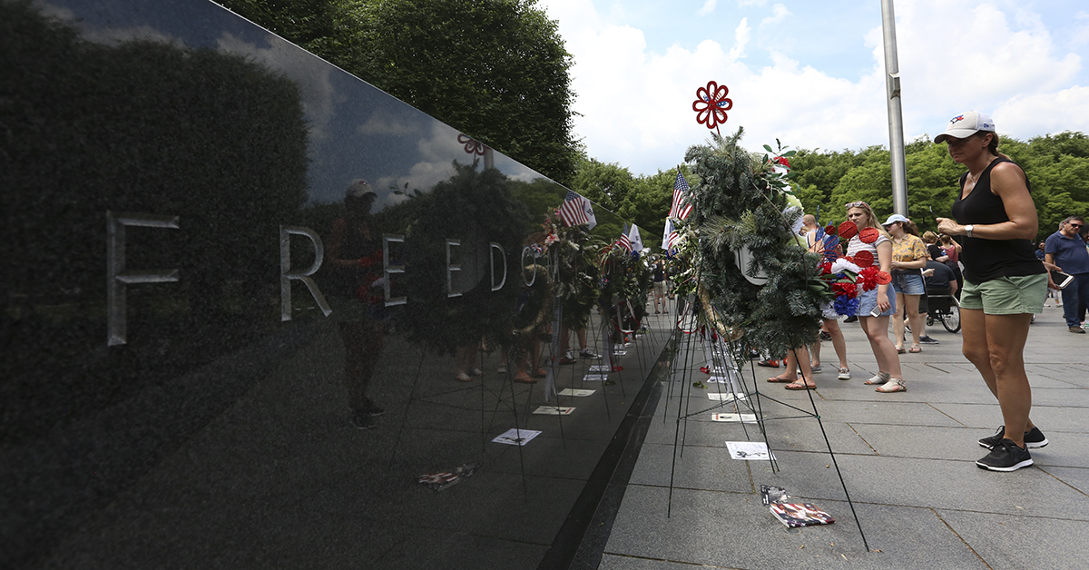 An onlooker looks at wreaths in the Korean War Memorial on Sunday, May 27 in Washington, D.C. during Memorial Day Weekend festivities throughout the city. (Ben Murray / Military Times)