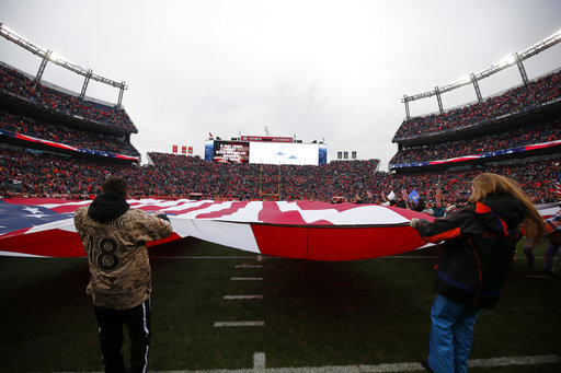 A U.S. flag covers the field before an NFL football game between the Denver Broncos and the Kansas City Chiefs on Dec. 31, 2017, in Denver. (Jack Dempsey/AP)