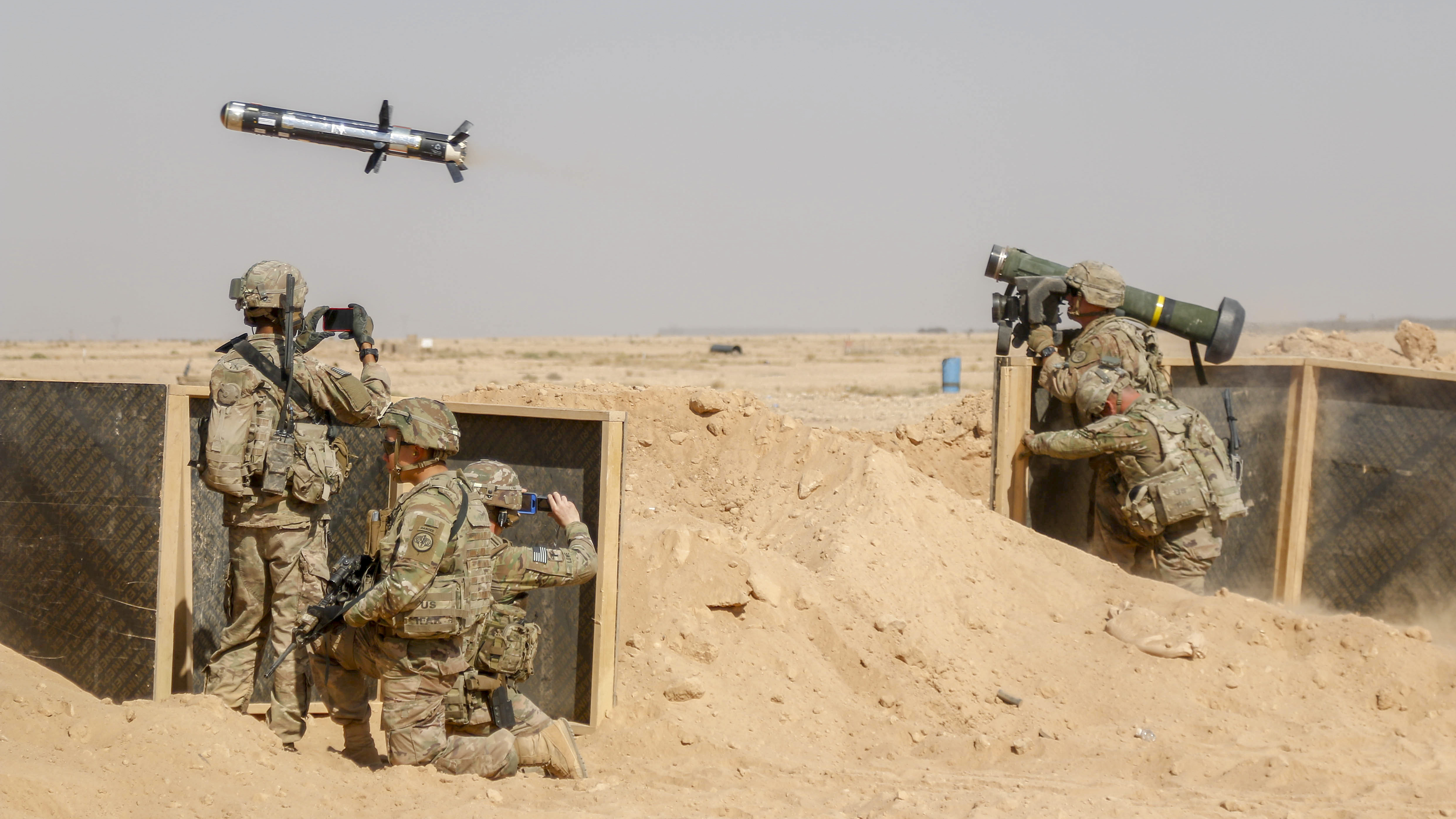 A U.S. Soldier assigned to the 3rd Cavalry Regiment and deployed in support of Combined Joint Task Force – Operation Inherent Resolve (CJTF-OIR) fires a Javelin anti-tank missile near Al Asad Air Base (AAAB), Iraq, Sept. 26, 2018. The Javelin was a part of a live-fire, react to contact training exercise involving M2A1 and M240B machine guns. AAAB is a CJTF-OIR enhanced partner capacity location dedicated to training partner forces and enhancing their effectiveness. (1st Lt. Leland White/Army National Guard)