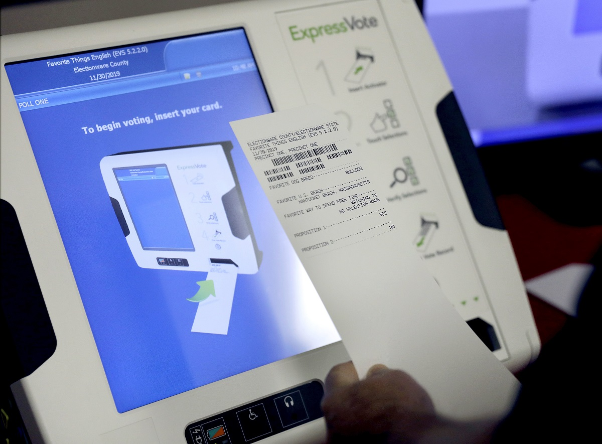 FILE - This Oct. 19, 2017, file photo shows a new voting machine which prints a paper record on display at a polling site in Conyers, Ga. Time and money are running short for states to replace aging or inadequate voting machines before the 2020 presidential primaries, according to a report released Tuesday, March 5, 2019. (AP Photo/David Goldman, File)