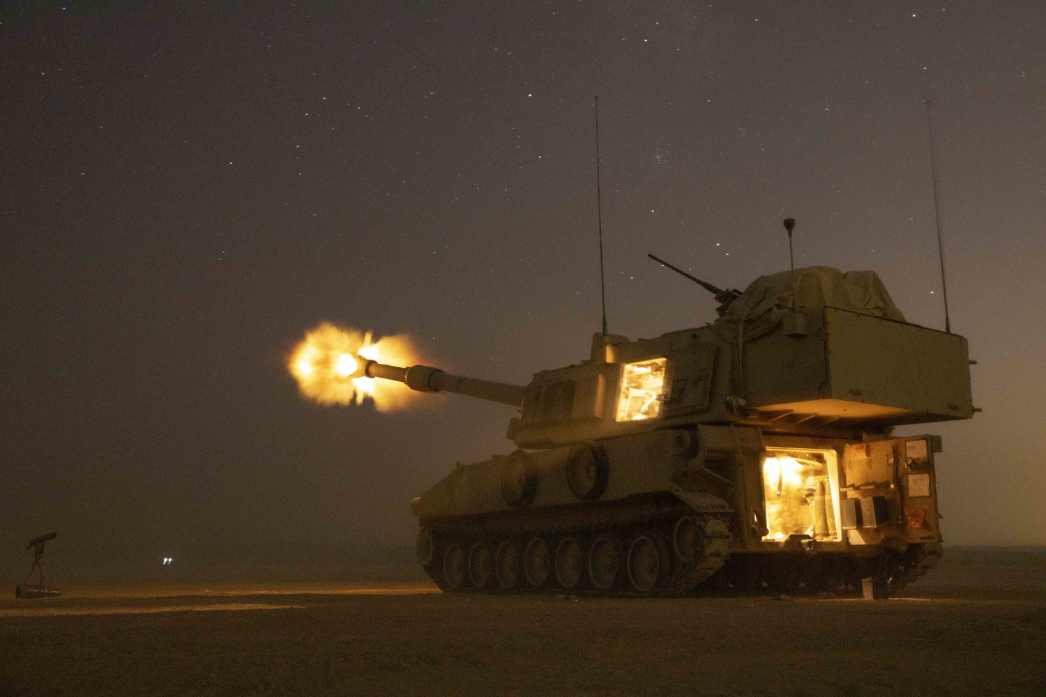 U.S. Army soldiers fire a M109A6 Paladin in support of the joint training exercise Eager Lion '19 at Training Area 1, Jordan, Aug. 27, 2019. (Spc. Angel Ruszkiewicz/Army)