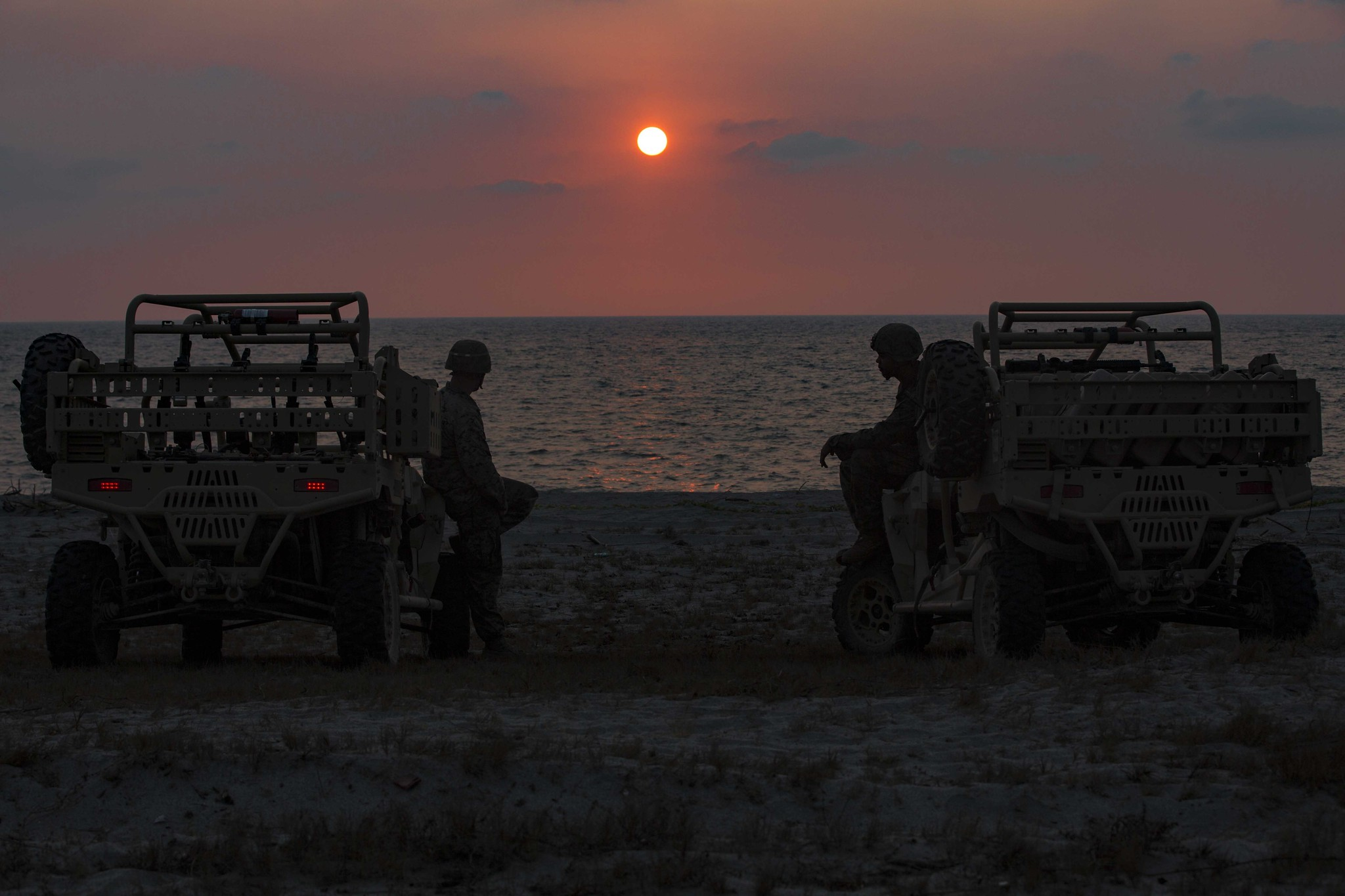 Marines sit on their Utility Terrain Vehicles observing the sunset April 7, 2019, after a training event at the Navy Education and Training Command, Philippines, during Exercise Balikatan. (Lance Cpl. Christian Ayers/Marine Corps)