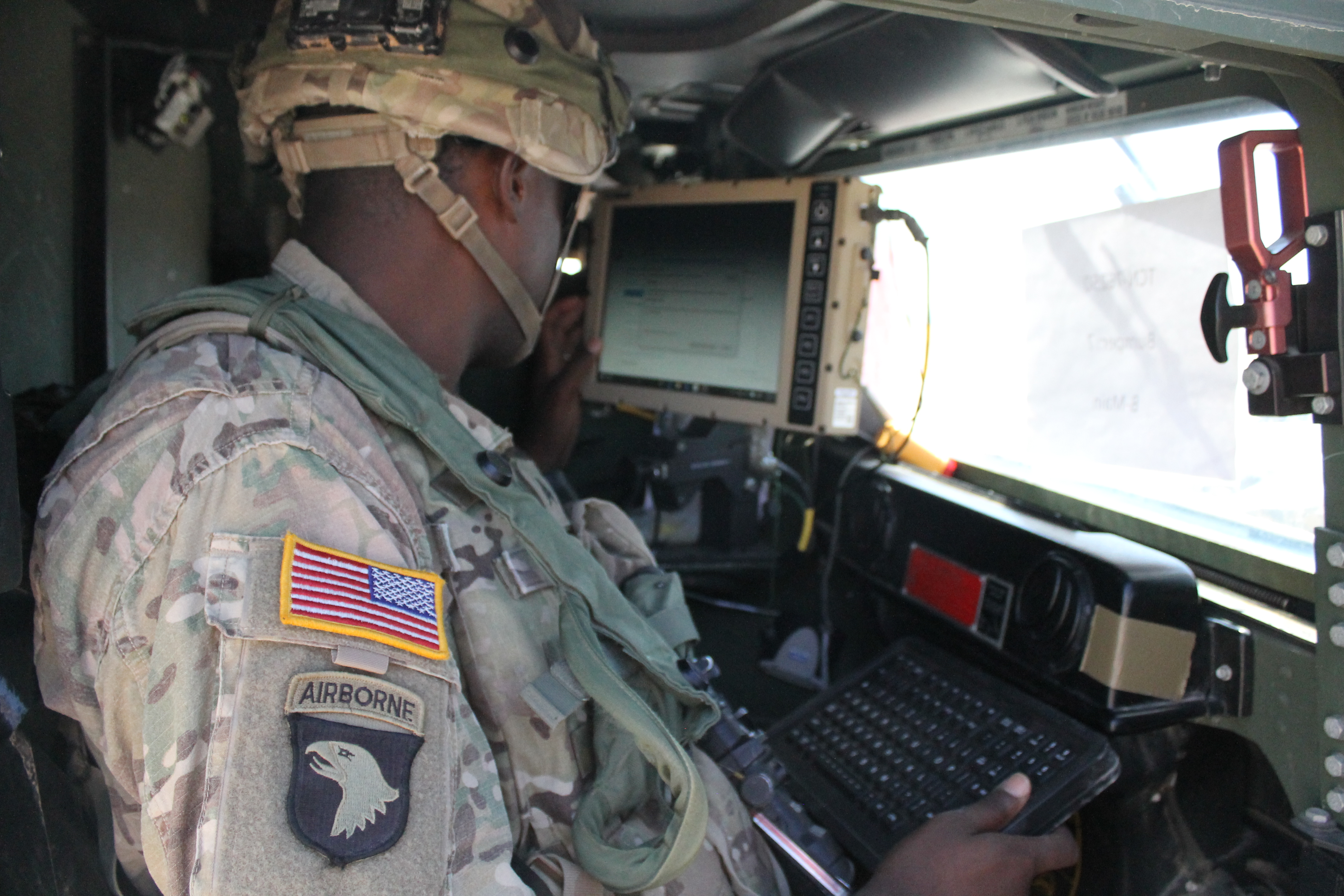 A soldier powers up the TCN-L in the cab of the Humvee. (Jen Judson/Staff)
