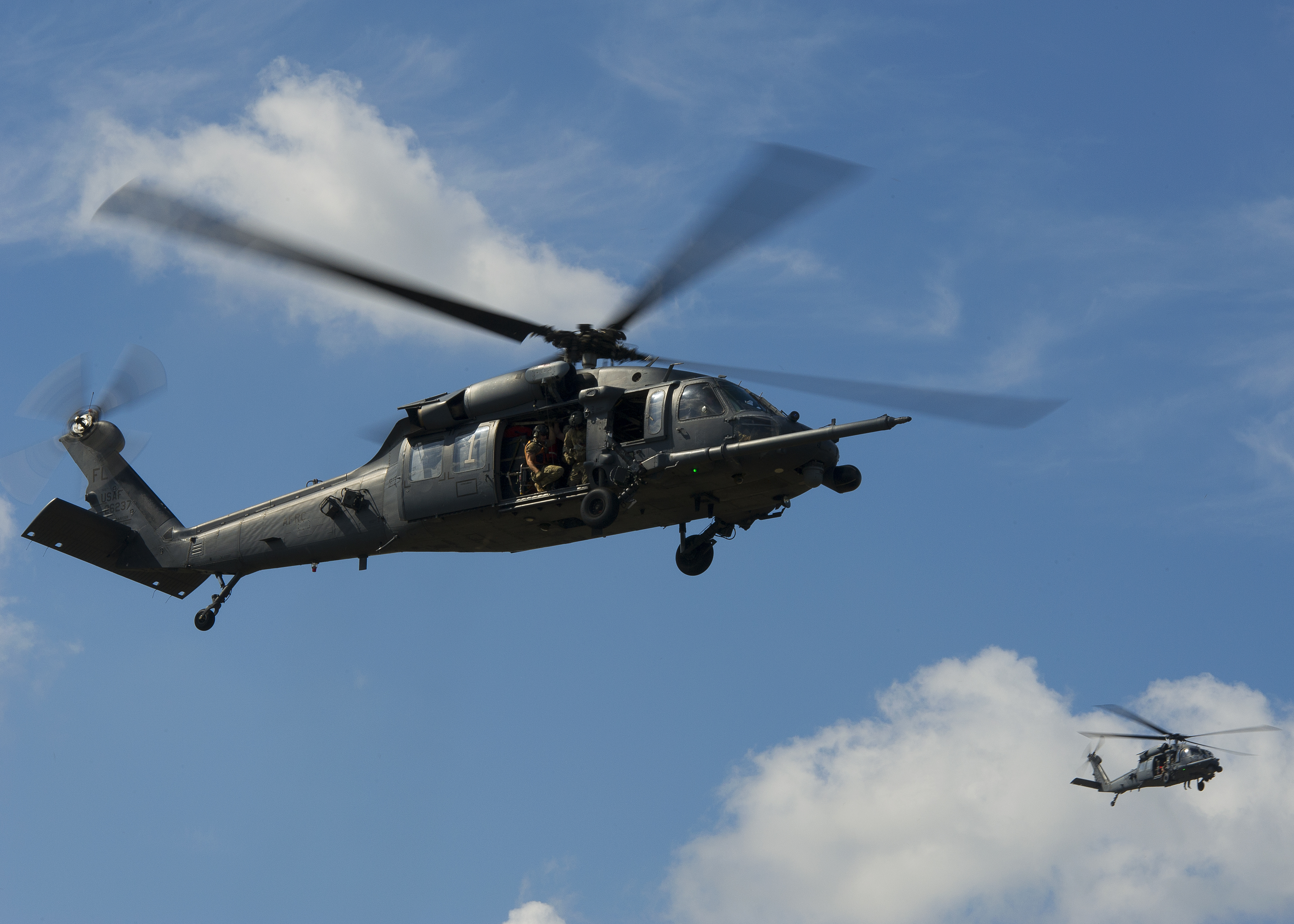 Two U.S. Air Force HH-60 Pave Hawk helicopters from the 301st Rescue Squadron, Patrick Air Force Base, Florida, performs maneuvers during a training scenario supporting pararescuemen at Guardian Centers, Perry, Georgia, October 11, 2017. (Master Sgt. Stephen D. Schester/Air Force)