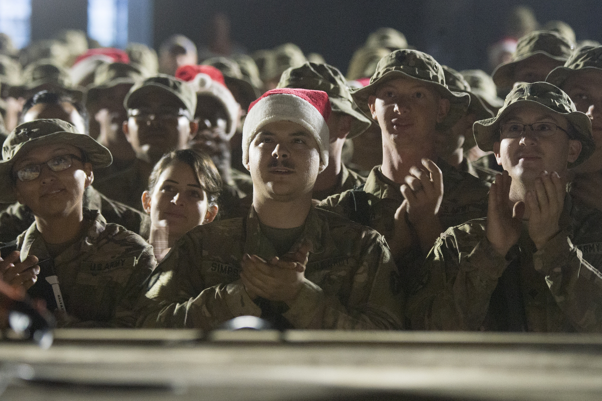 Soldiers from the 3rd and 4th Brigade 10th Mountain Division watch the USO Holiday Tour at Qayyarah West. (Navy Petty Officer 1st Class Dominique A. Pineiro/Dept. of Defense)