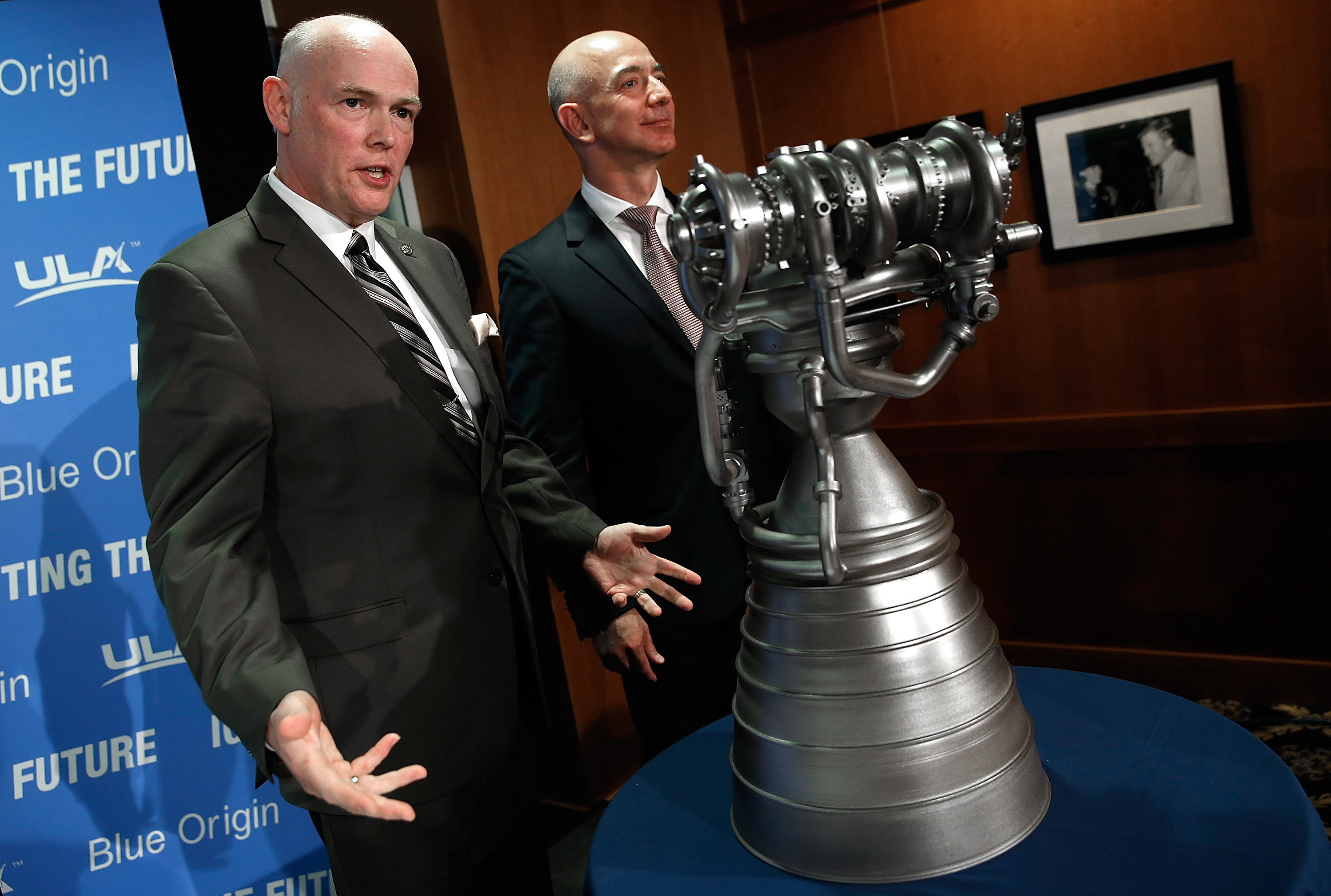 Jeff Bezos, right, the founder of Blue Origin, and Tory Bruno, the CEO of United Launch Alliance, display the BE-4 rocket engine during a news conference on Sept. 17, 2014. (Win McNamee/Getty Images)