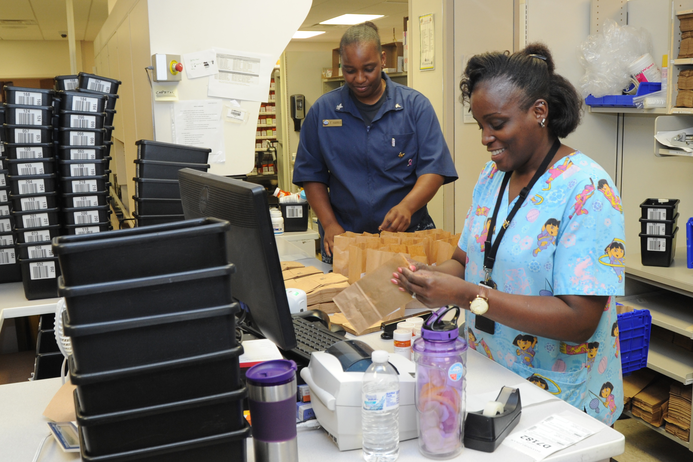 Wanda Ward, a pharmacy tech at Naval Hospital Pensacola, fills a prescription for Tricare beneficiaries June 11. Prescriptions are available at military treatment facilities at no cost to patients; at retail pharmacies and by mail, costs will rise in 2020.