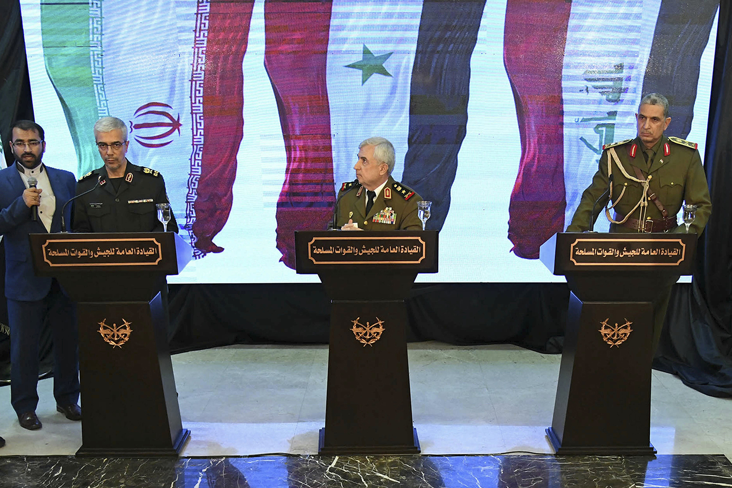 Iran's Chief of Staff of Armed Forces, Maj. Gen. Mohammad Hossein Bagheri, left, speaks during a March 18, 2019, press conference with Syria's defense minister Gen. Ali Ayoub, center, and Iraqi army commander, Gen. Osman Ghanemi in Damascus, Syria. (SANA via AP)