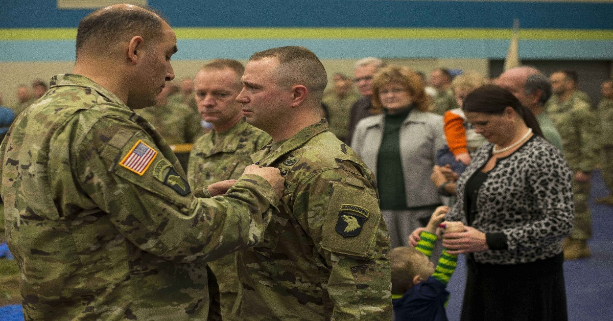 Maj. Gen. Andrew Poppas, the 101st Airborne Division commanding general, pins the Soldier's Medal on Staff Sgt. Nicholas Davis during a ceremony held at Fort Campbell, Ky., Jan. 22.(Sgt. Samantha Stoffregen/ Army)