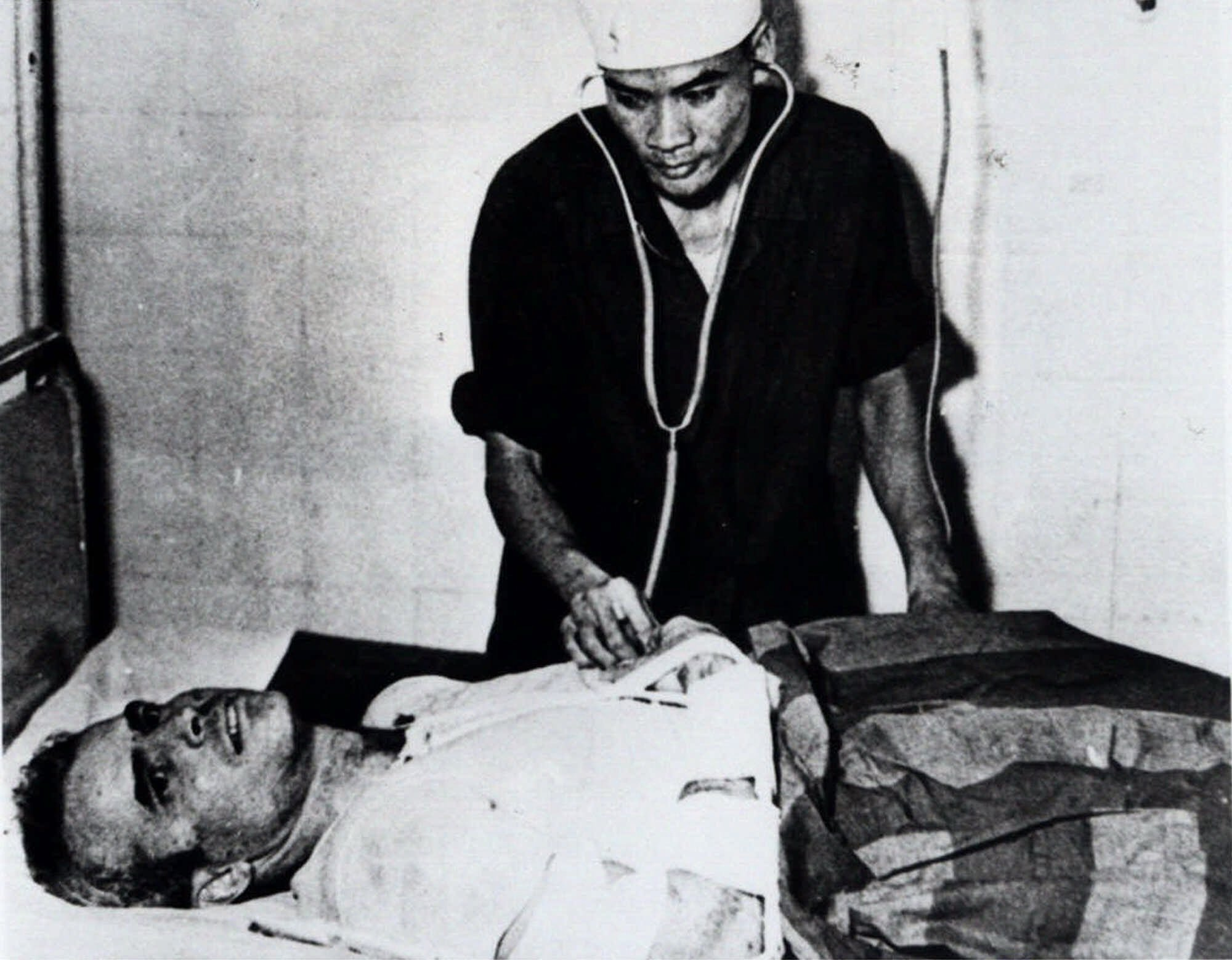 John McCain is administered to a Hanoi, Vietnam, hospital as a prisoner of war in the fall of 1967. McCain spent 20 years in the U.S. Navy, a quarter of it in a Vietnamese POW camp after his jet was shot down over Hanoi during an Oct. 26, 1967, bombing mission. (AP)