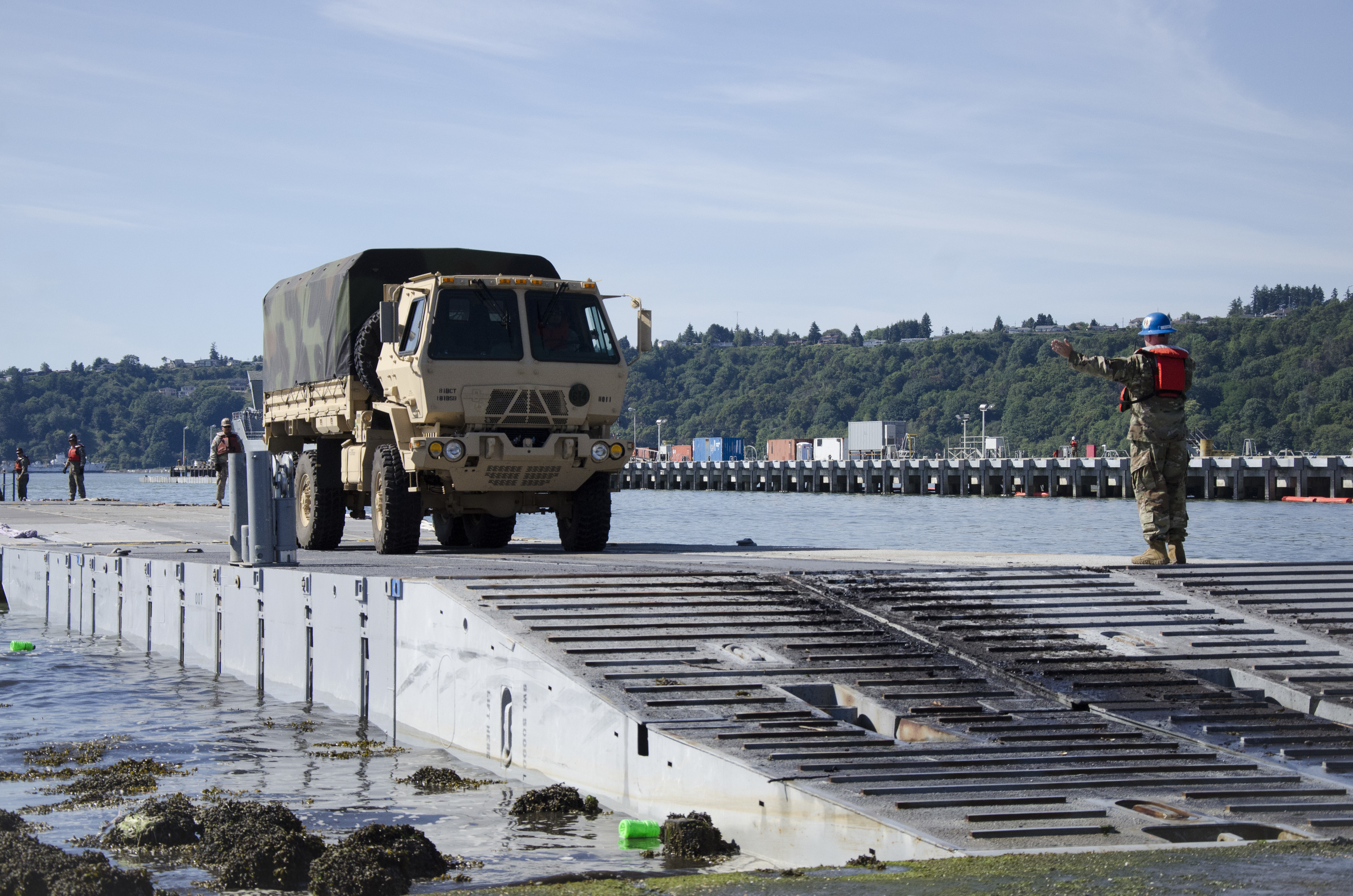 Soldiers from the Washington Army National Guard's 181st Brigade Support Battalion and US Army's 7th Transportation Brigade (Expeditionary) load trucks during a Joint Logistics Over the Shore (JLOTS) exercise at the Port of Tacoma in support of Cascadia Rising 2016 on June 5, 2016. Cascadia Rising 2016 is a full-scale exercise involving over 100 federal, state, county and city agencies designed to test the state's earthquake plan in the event of a Cascadia Subduction Zone event. (U.S. Army National Guard photo by Sgt. Michael Tietjen)