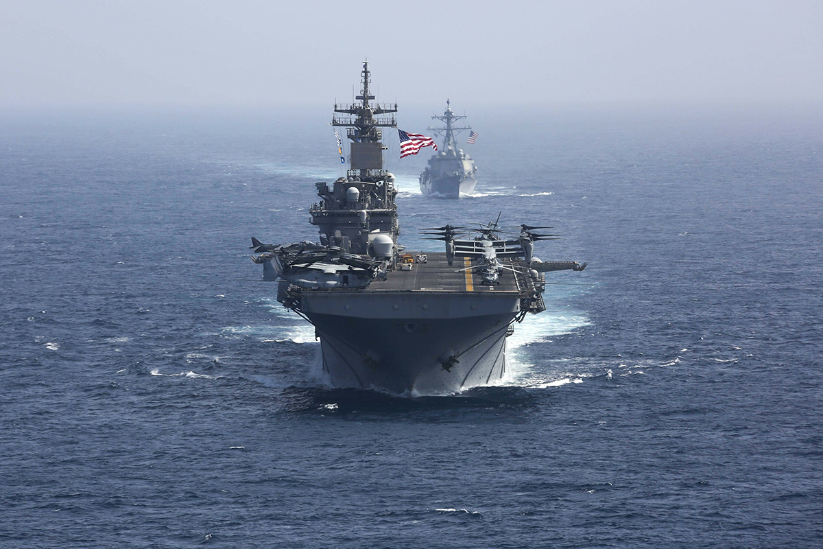 The amphibious assault ship USS Kearsarge and the Arleigh Burke-class guided-missile destroyer USS Bainbridge sail in formation May 17, 2019, as part of the USS Abraham Lincoln aircraft carrier strike group in the Arabian Sea. (Mass Communication Specialist 1st Class Brian M. Wilbur/U.S. Navy via AP)