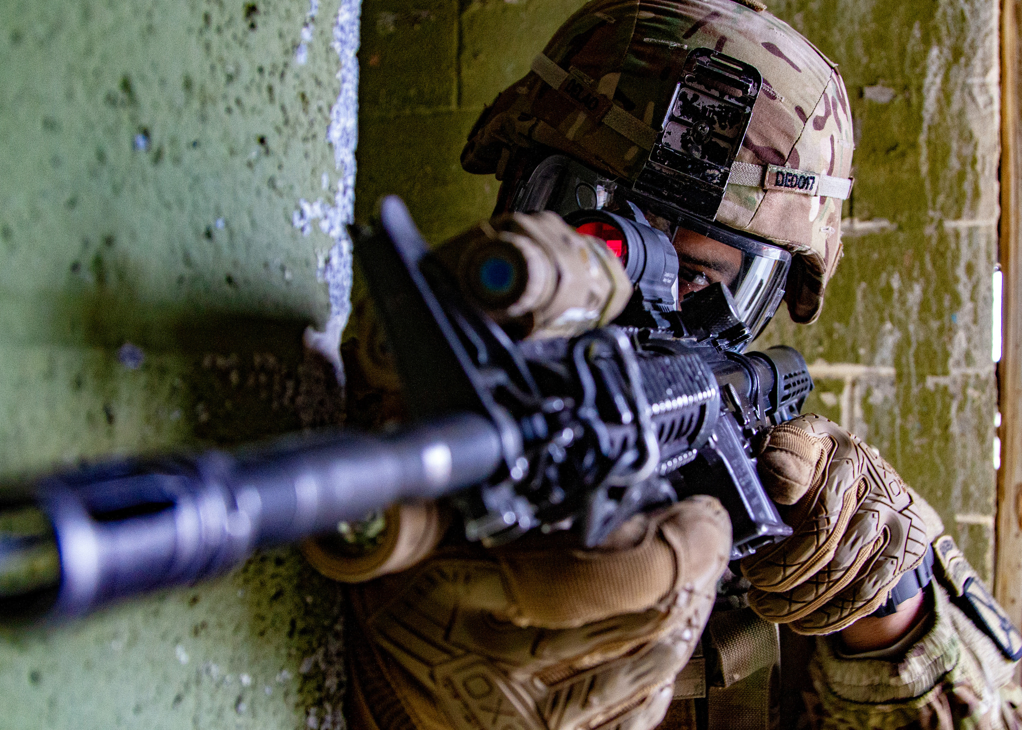 Capt. De Lao guards the corner of a hallway in a mock chemical environment during subterranean environment training at the platoon level at the Combined Arms Collective Training Facility at Fort Drum, N.Y., Nov 15, 2018. (Staff Sgt. James Avery/Army)