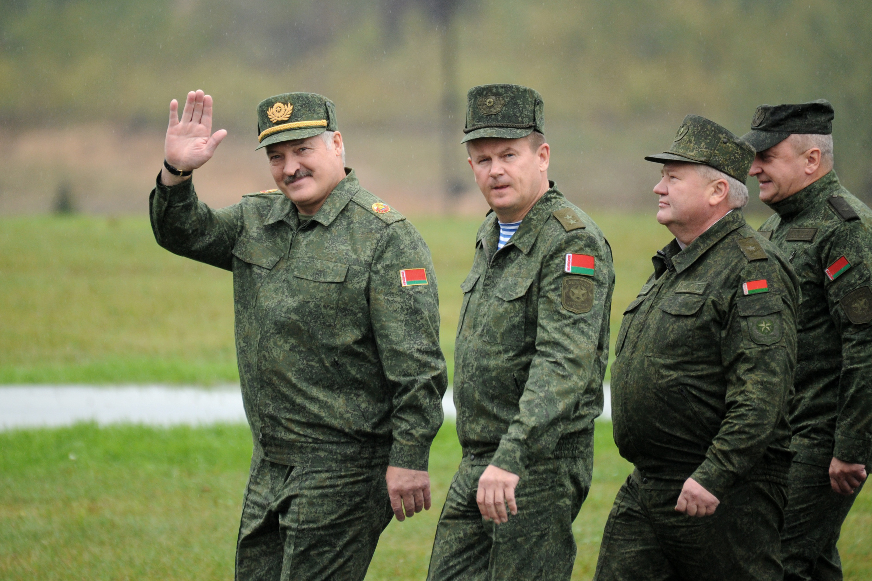 Belarus' President Alexander Lukashenko (L) waves as he arrives to inspect the joint Russian-Belarusian military exercises Zapad-2017 (West-2017) at a training ground near the town of Borisov on Sept. 20, 2017. (Photo by Sergei Gapon/AFP/Getty Images)