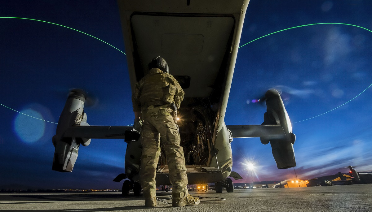 An airman assigned to the 14th Weapons Squadron at Hurlburt Field, Fla., stands outside a CV-22 Osprey before a night mission during the U.S. Air Force Weapons School advanced integration course at Nellis Air Force Base, Nev., Dec. 10, 2017. (Senior Airman Kevin Tanenbaum/Air Force)