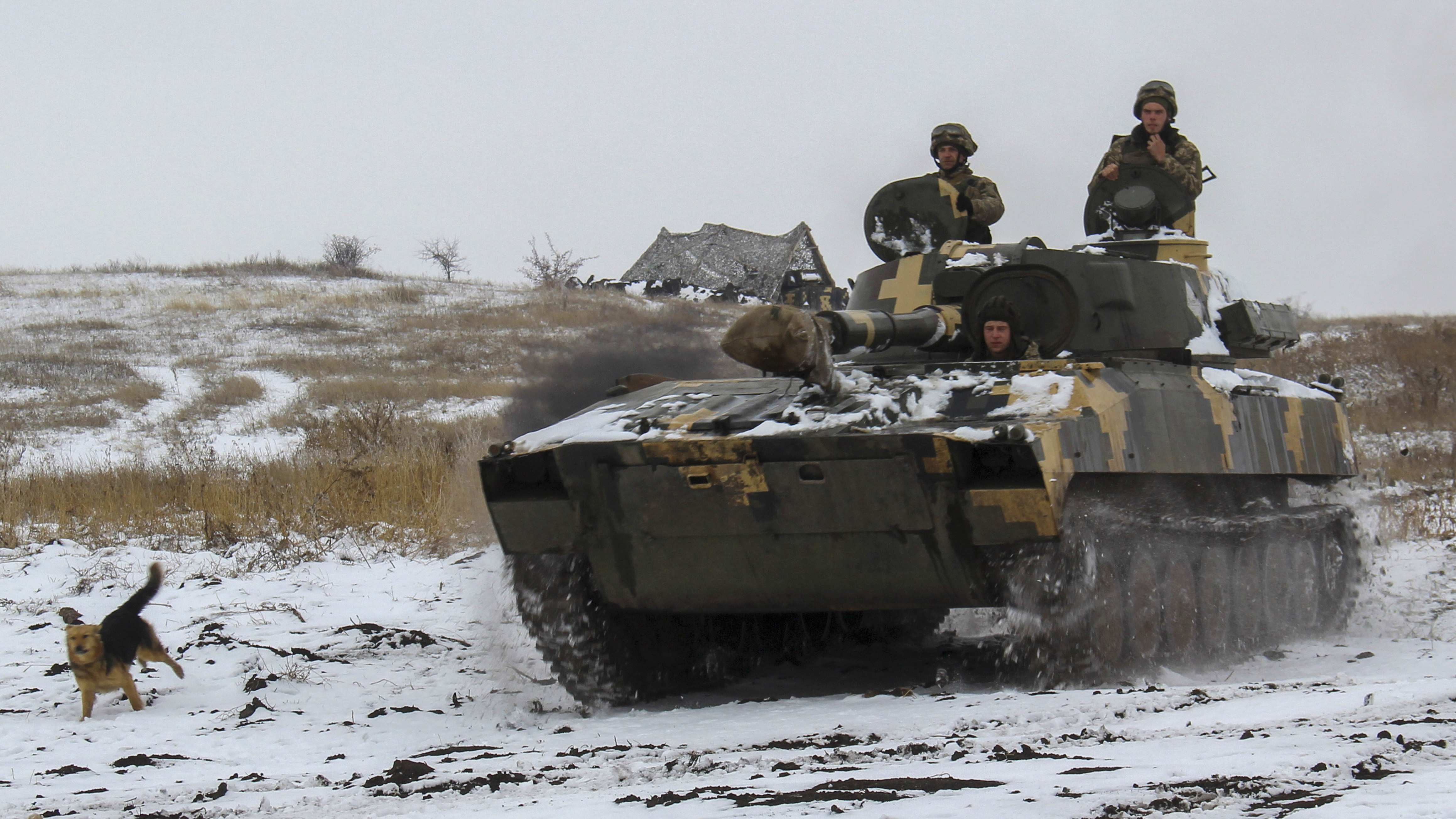 A Ukraine army APC moves toward on position at an undisclosed location in eastern Ukraine, Monday, Nov. 26, 2018. Ukrainian lawmakers were set to consider a presidential request for the introduction of martial law in the country on Monday following an incident in which Russian coast guard ships fired on Ukrainian navy vessels. (AP Photo/Alexander Shulman)