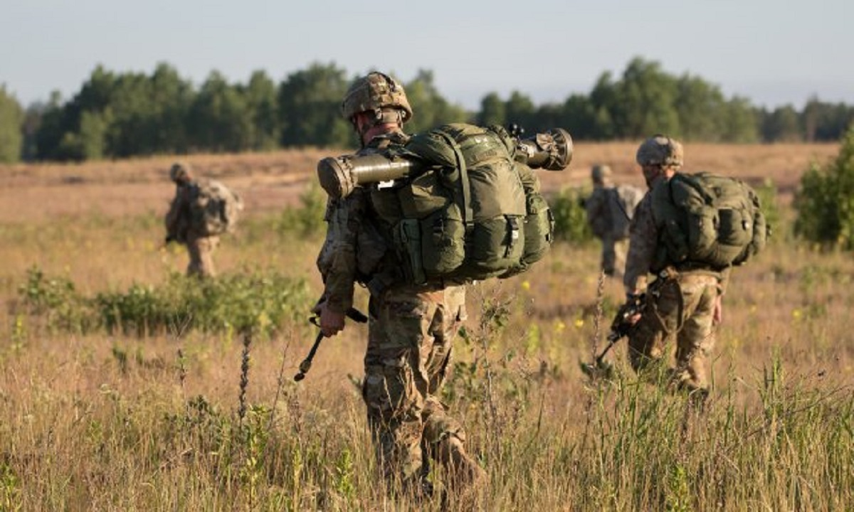 U.S. Army paratroopers ruck to a meeting point after jumping from an aircraft near Rukla, Lithuania, as part of Swift Response 18. (U.S. Army)