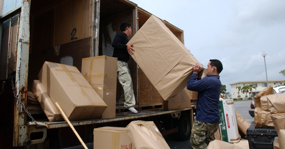 The more prep work you put in before the move, the smoother moving day will be. Here, movers pack up household goods at Kadena Air Base on Okinawa, Japan. (Senior Airman Jeremy McGuffin/Air Force)
