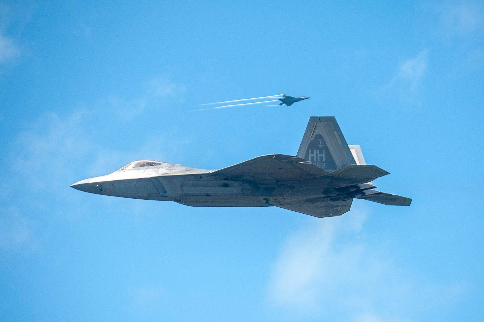 Hawaii Air National Guard F-22 Raptors from Joint Base Pearl Harbor-Hickam practice low approaches April 25, 2019, at the Palau International Airport, Republic of Palau. The fifth-generation-fighter aircraft landed in Palau for the first time as part of Resilient Typhoon, a Pacific Air Forces aircraft dispersal exercise. (Senior Airman John Linzmeier/Air National Guard)