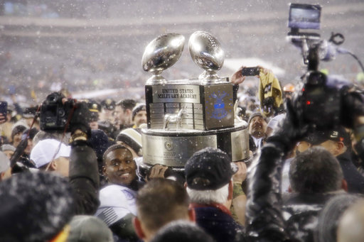 Army's Ahmad Bradshaw holds up the Commander in Chief's Trophy after the Black Knights bested Navy on Saturday in Philadelphia. (Matt Rourke/AP)