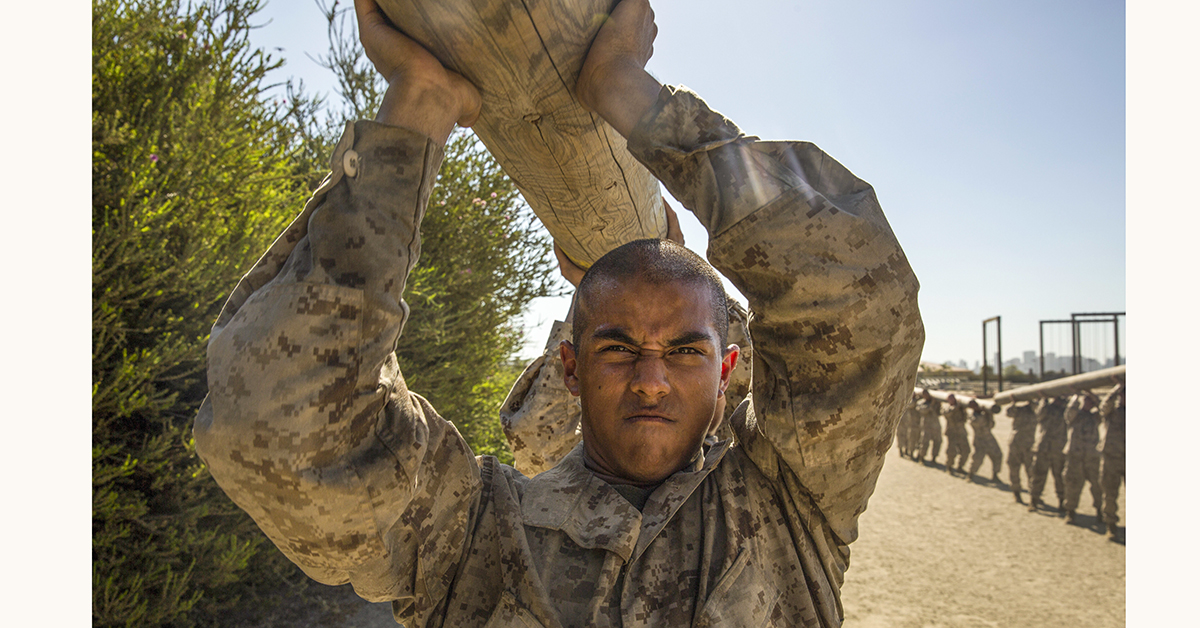 Recruits with India Company, 3rd Recruit Training Battalion, carry logs during a log drill exercise at Marine Corps Recruit Depot San Diego, July 23rd as part of their physical training. (Lance Cpl. Christian Garcia/Marines)