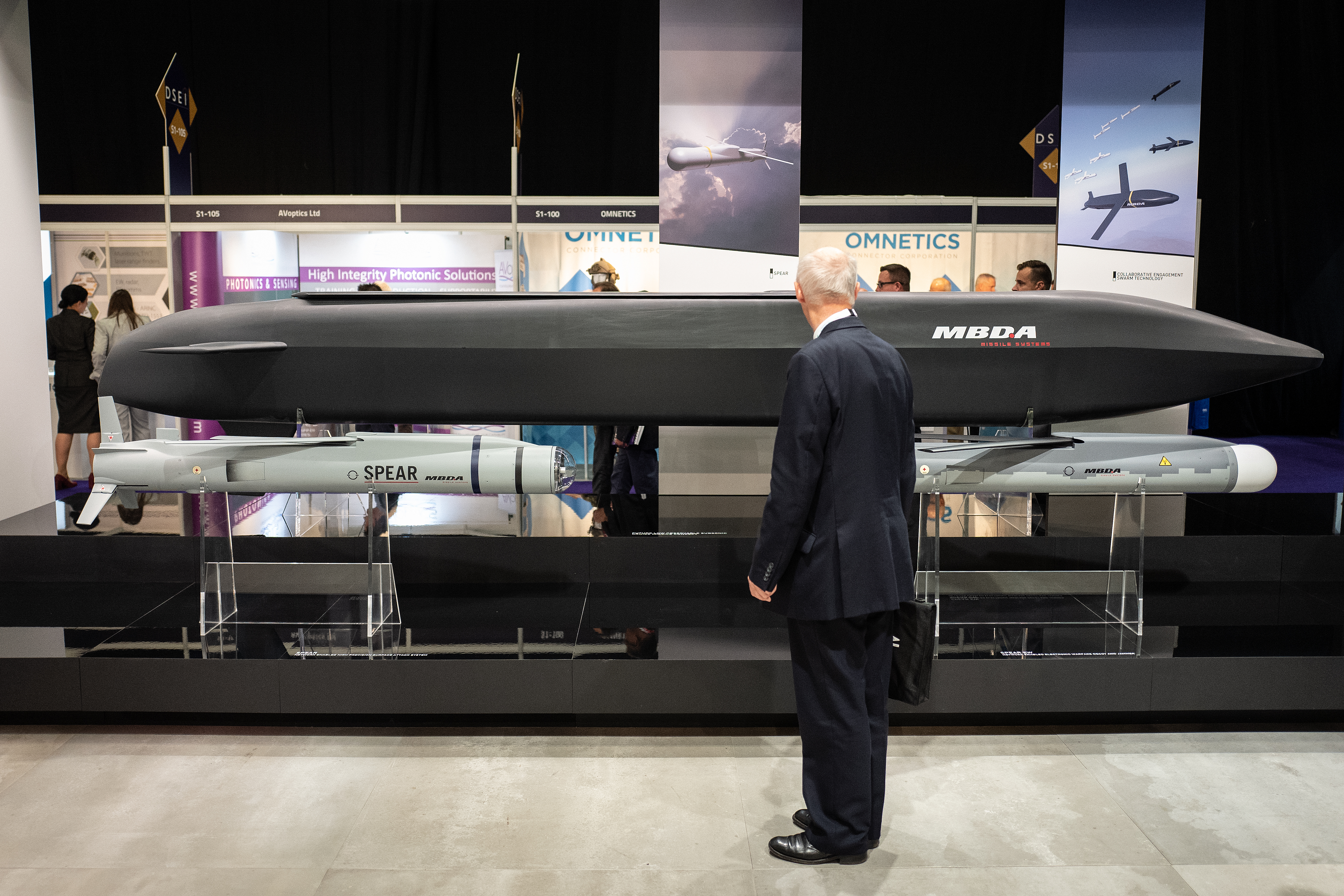 A delegate looks at the MBDA Spear network-enabled high-precision surface attack system left, a