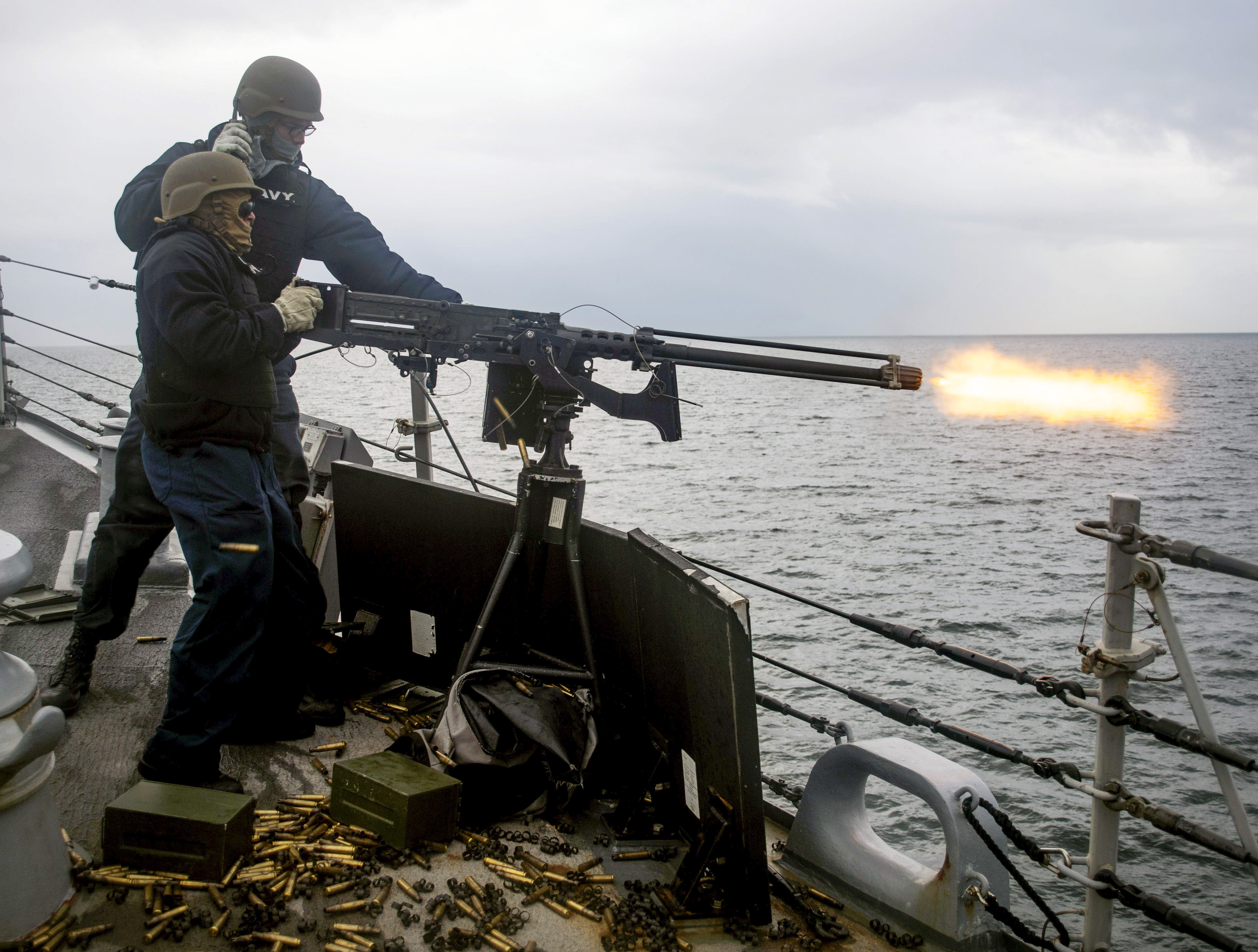 Sailors assigned to the guided-missile destroyer Ross fire a .50-caliber machine gun during exercise Joint Warrior 18-1 off the coast of Scotland. (MC1 Kyle Steckler/Navy)