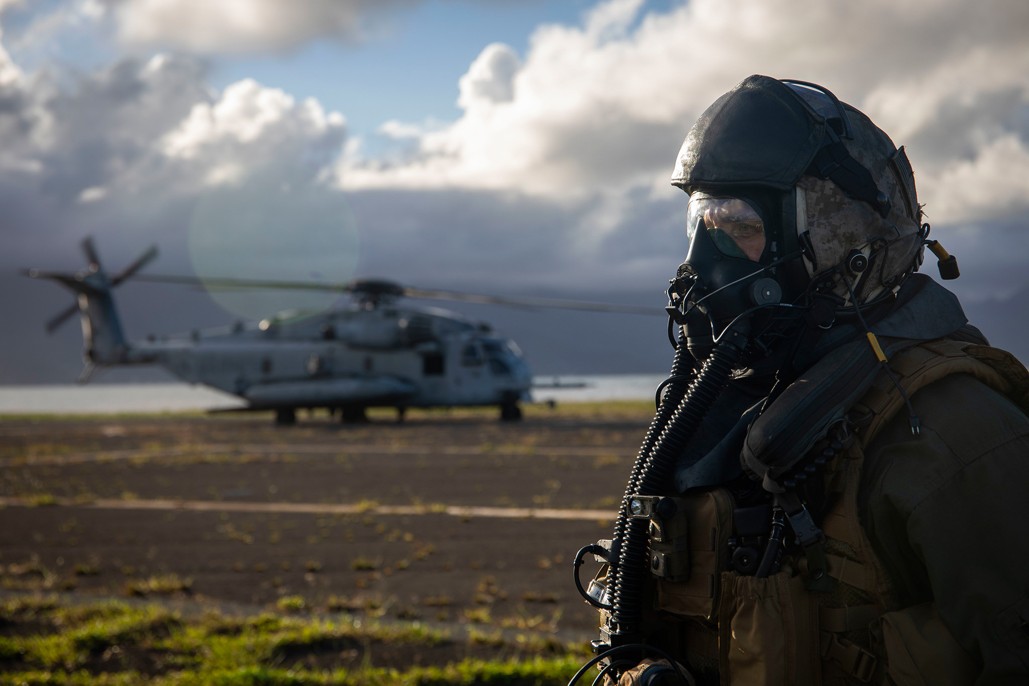 Maj. Ryan Pallas, a CH-53 Super Stallion helicopter pilot with Marine Heavy Helicopter Squadron (HMH) 463, stands by after donning his gas mask prior to a Helicopter Support Team (HST) exercise at Landing Zone Westfield, Marine Corps Base Hawaii. (Sgt. Zachary Orr/Marine Corps)