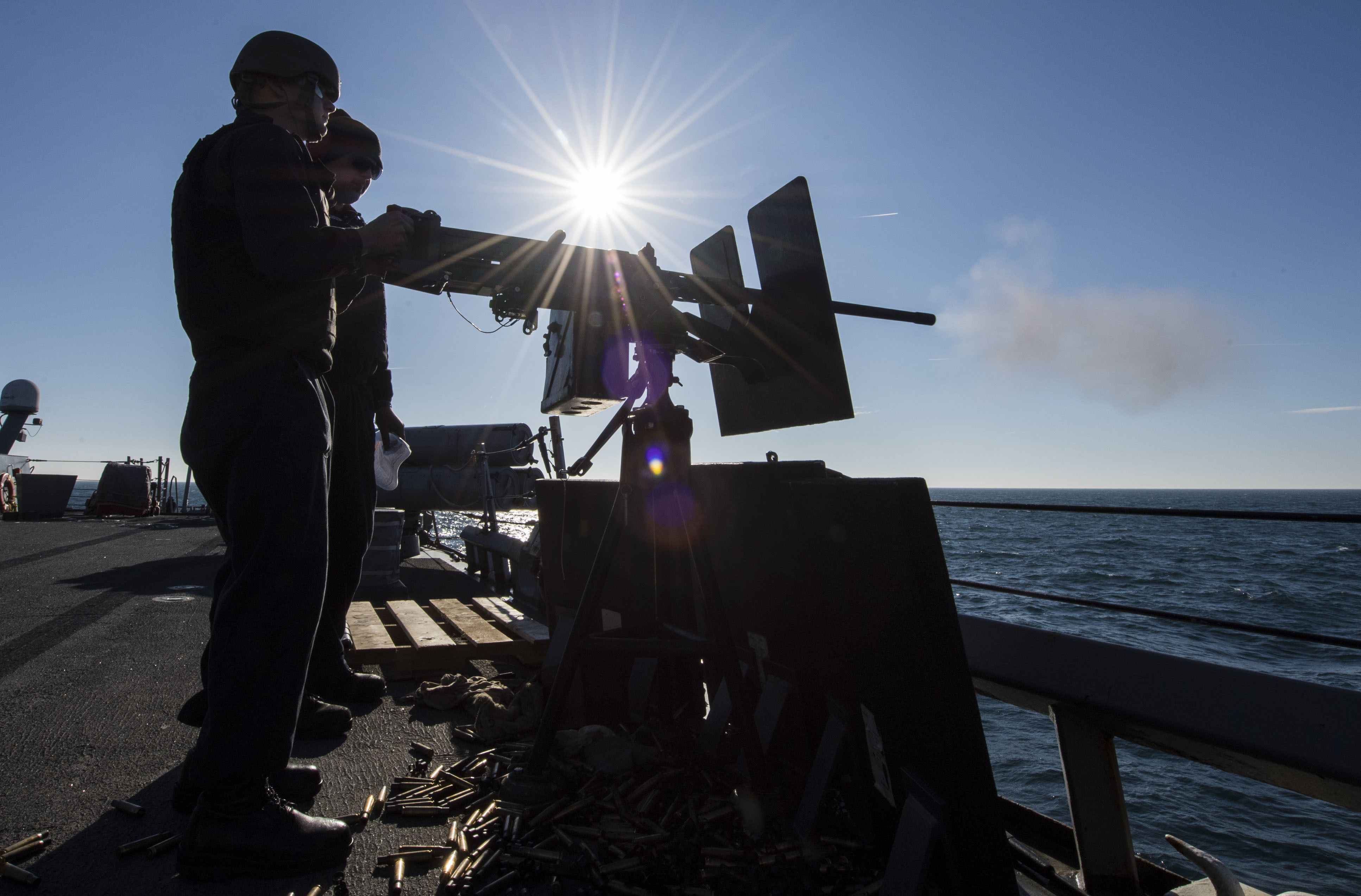 Sonar Technician (Surface) 2nd Class Jacob Ferrantino fires a .50-caliber machine gun aboard the Arleigh Burke-class guided-missile destroyer USS Carney during a live-fire exercise in the Black Sea, Jan. 6, 2018. (U.S. Navy photo by James R. Turner)