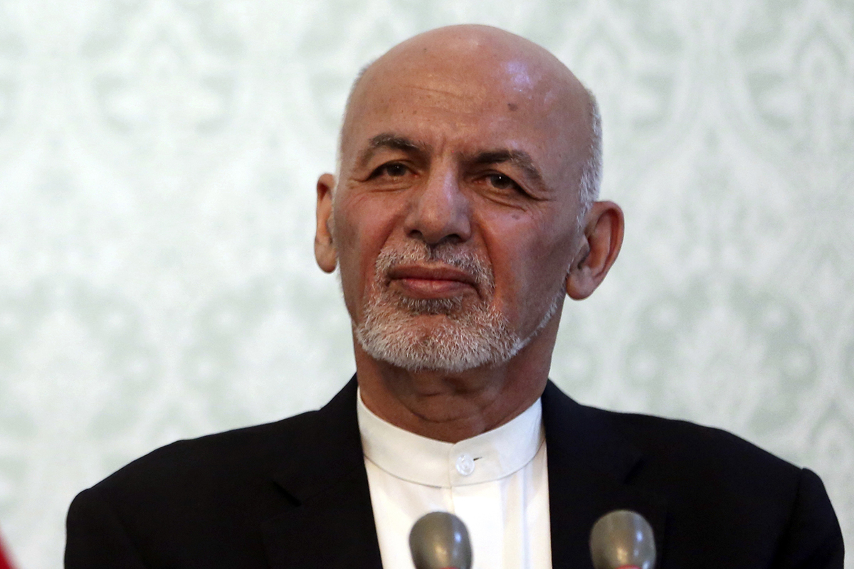 In this Nov. 6, 2018, photo, Afghan President Ashraf Ghani, listens during a news conference with NATO Secretary General Jens Stoltenberg, at the presidential palace, in Kabul, Afghanistan. (Massoud Hossaini/AP)